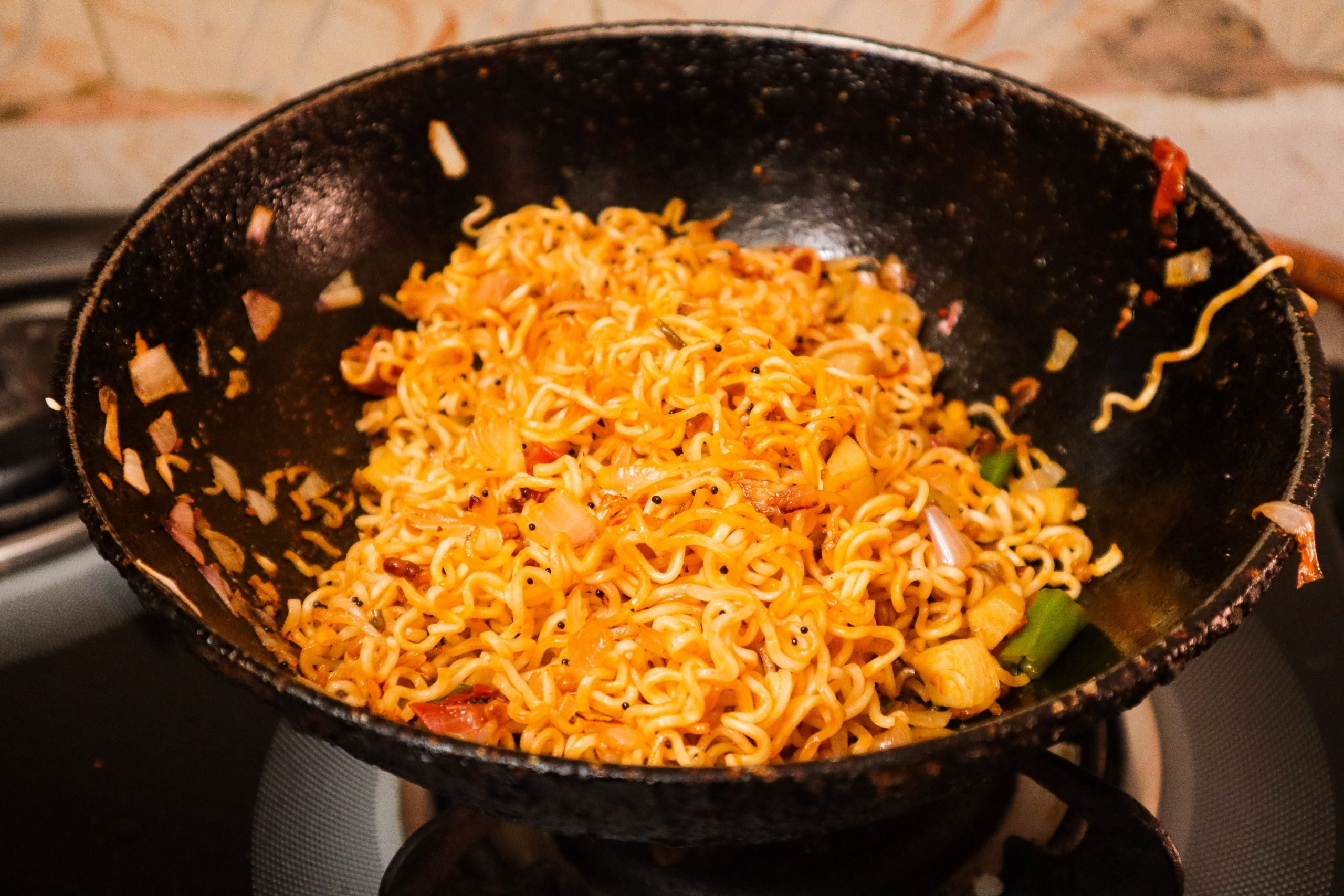 Cooking noodles in a deep fry pan