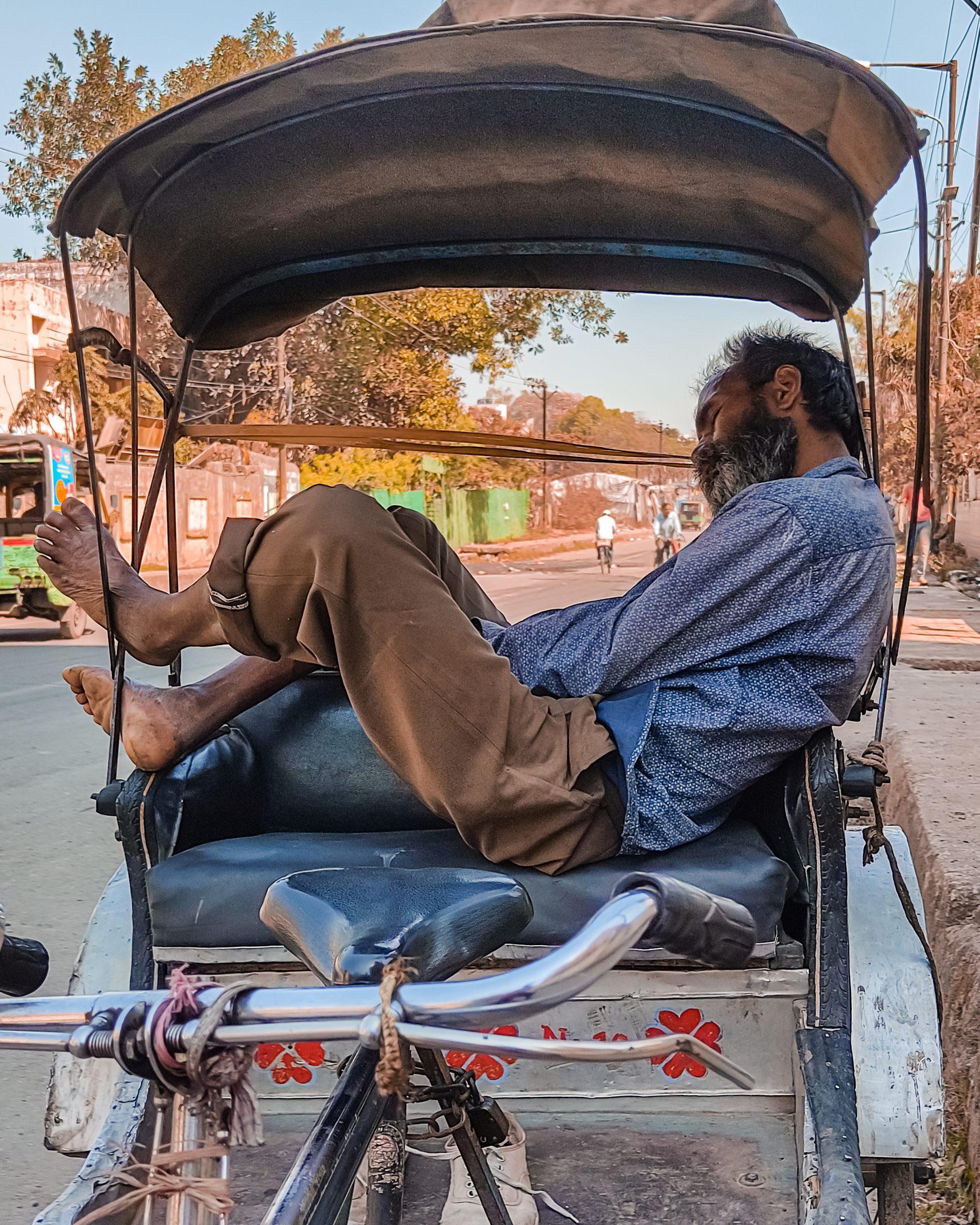 Old man sleeping the rickshaw