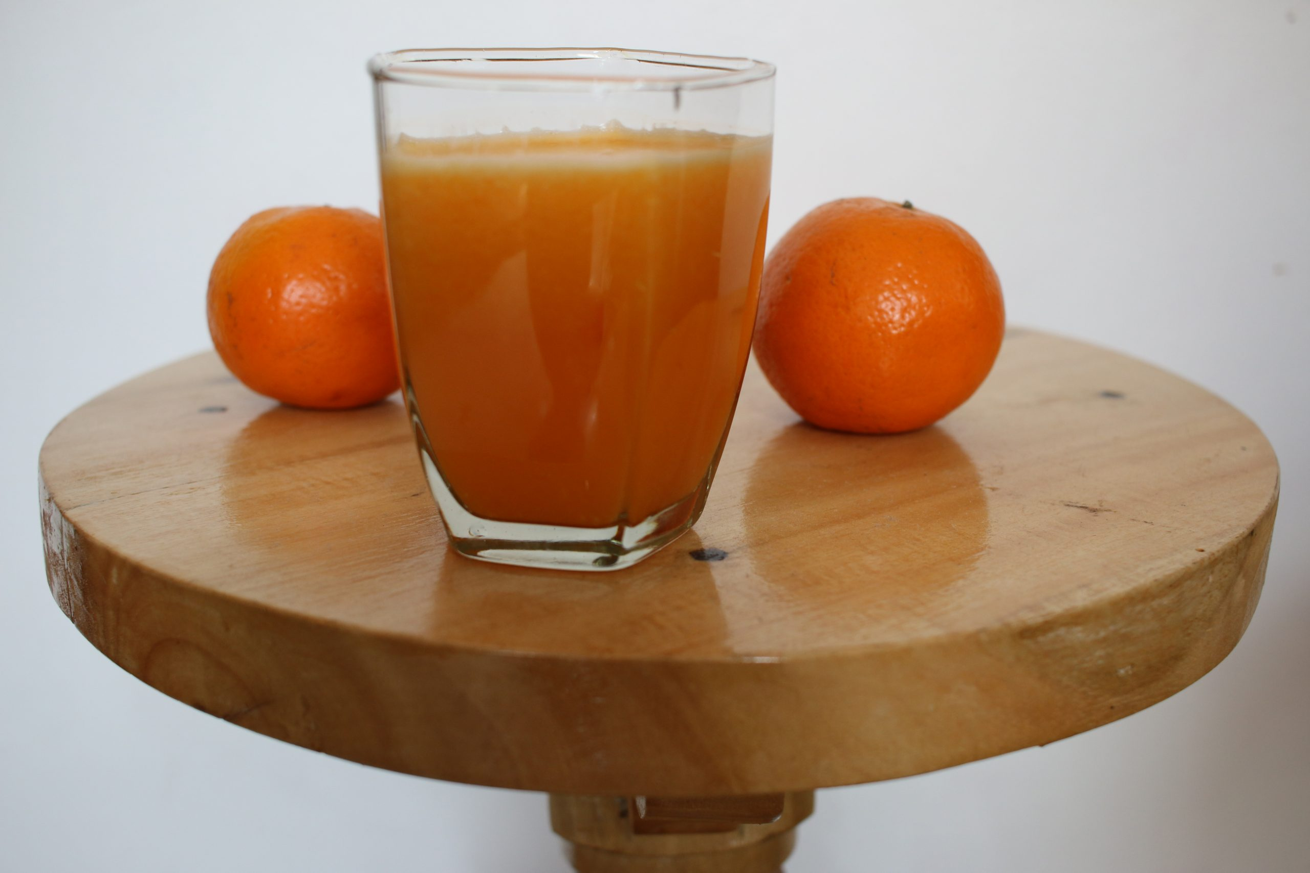 An orange juice glass