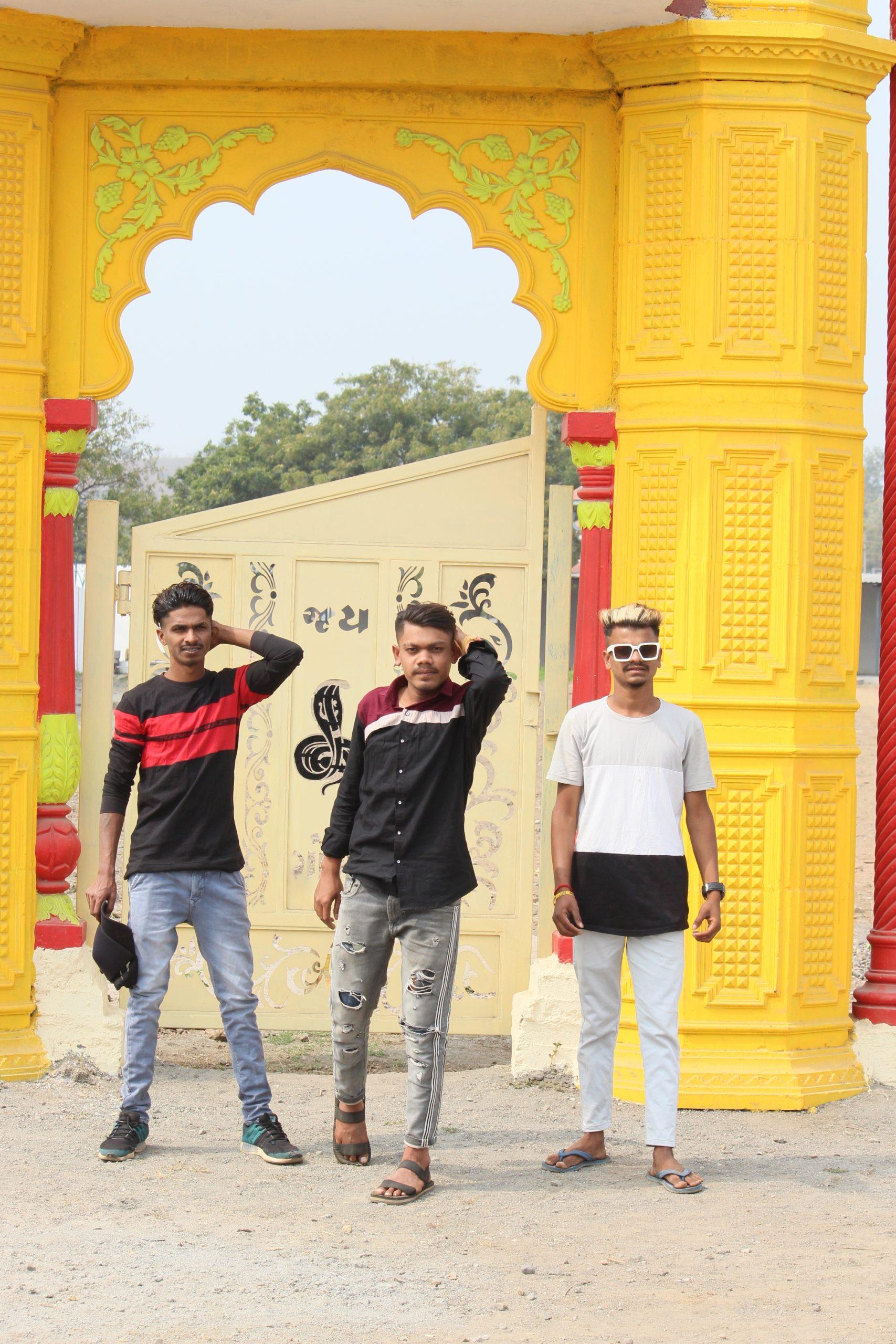 Three boys near a gate