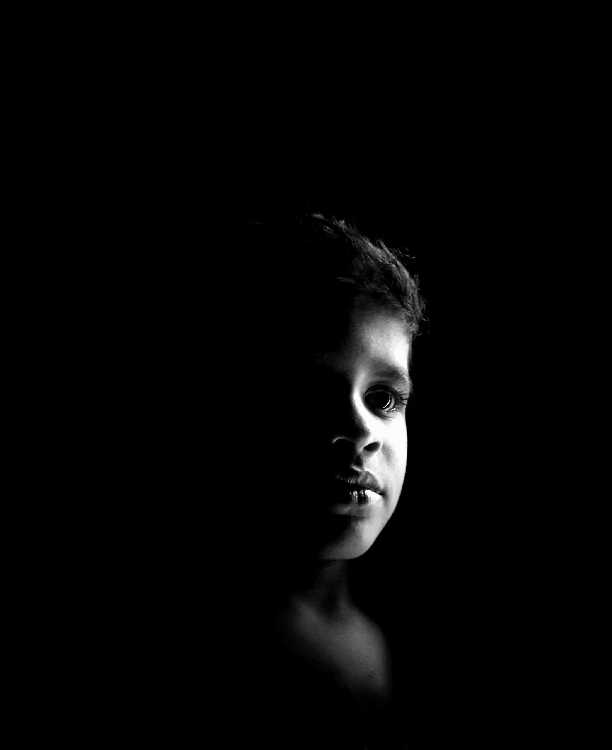 Black and white portrait of a kid