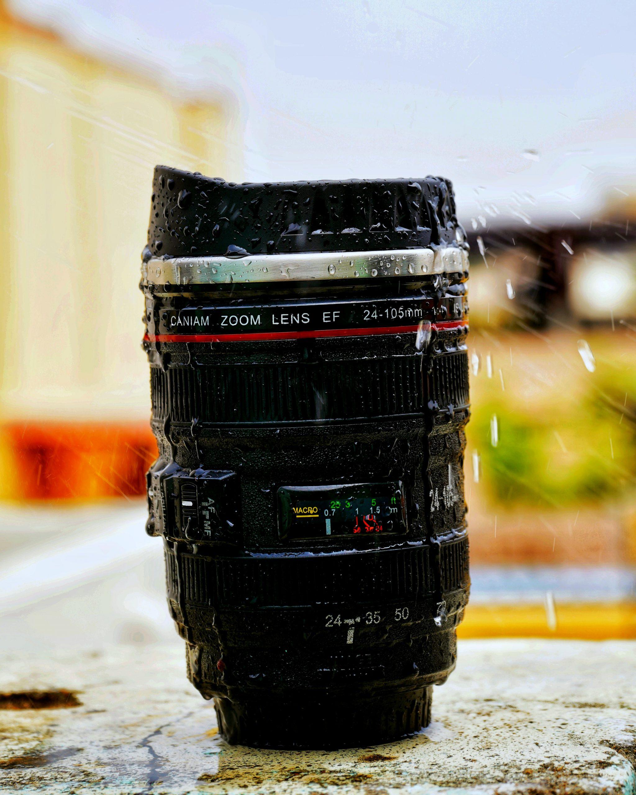 Rain drops falling on a camera lens
