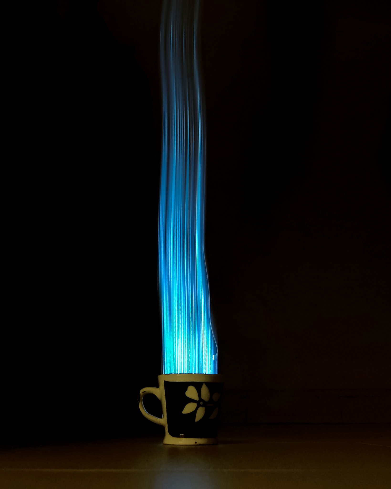 Blue lights beaming from a cup