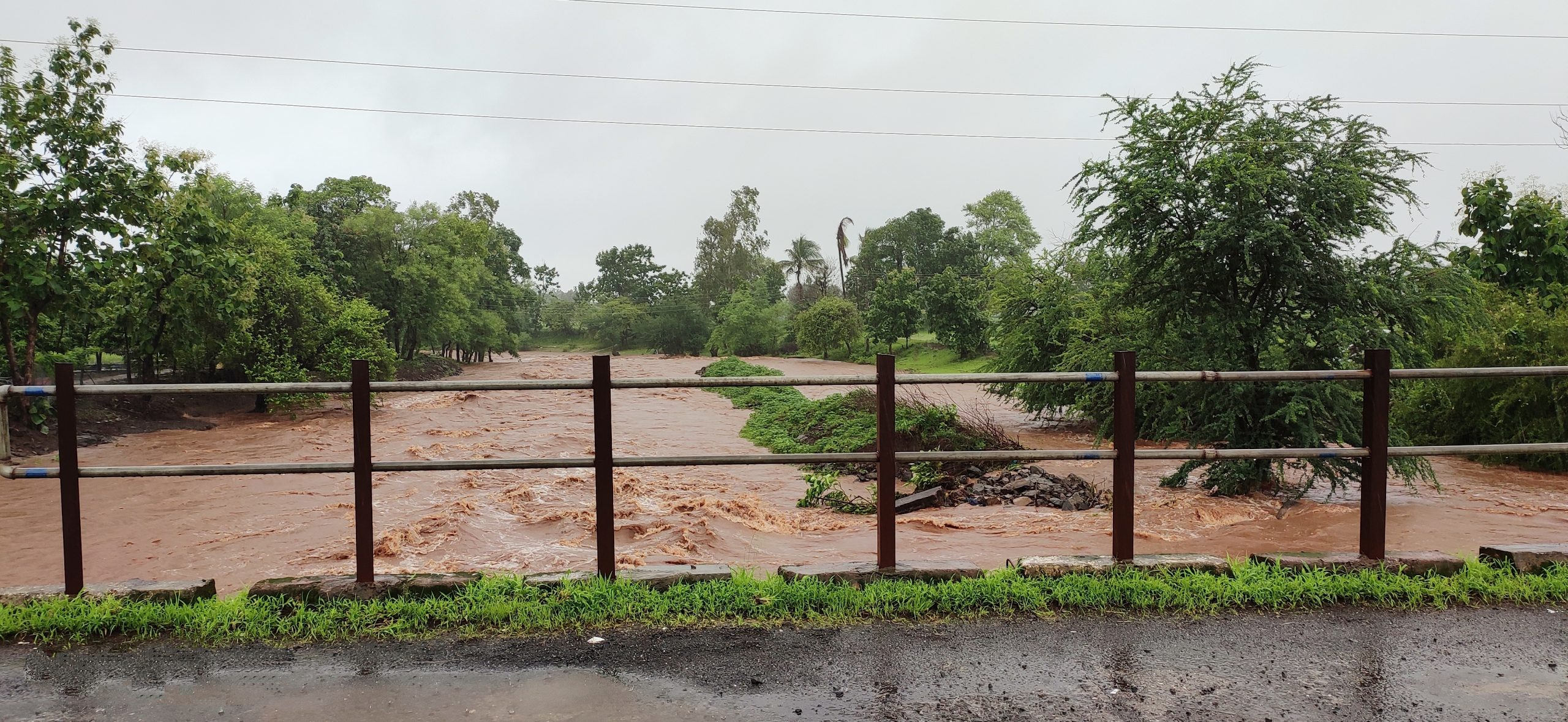River flooding and a bridge railing