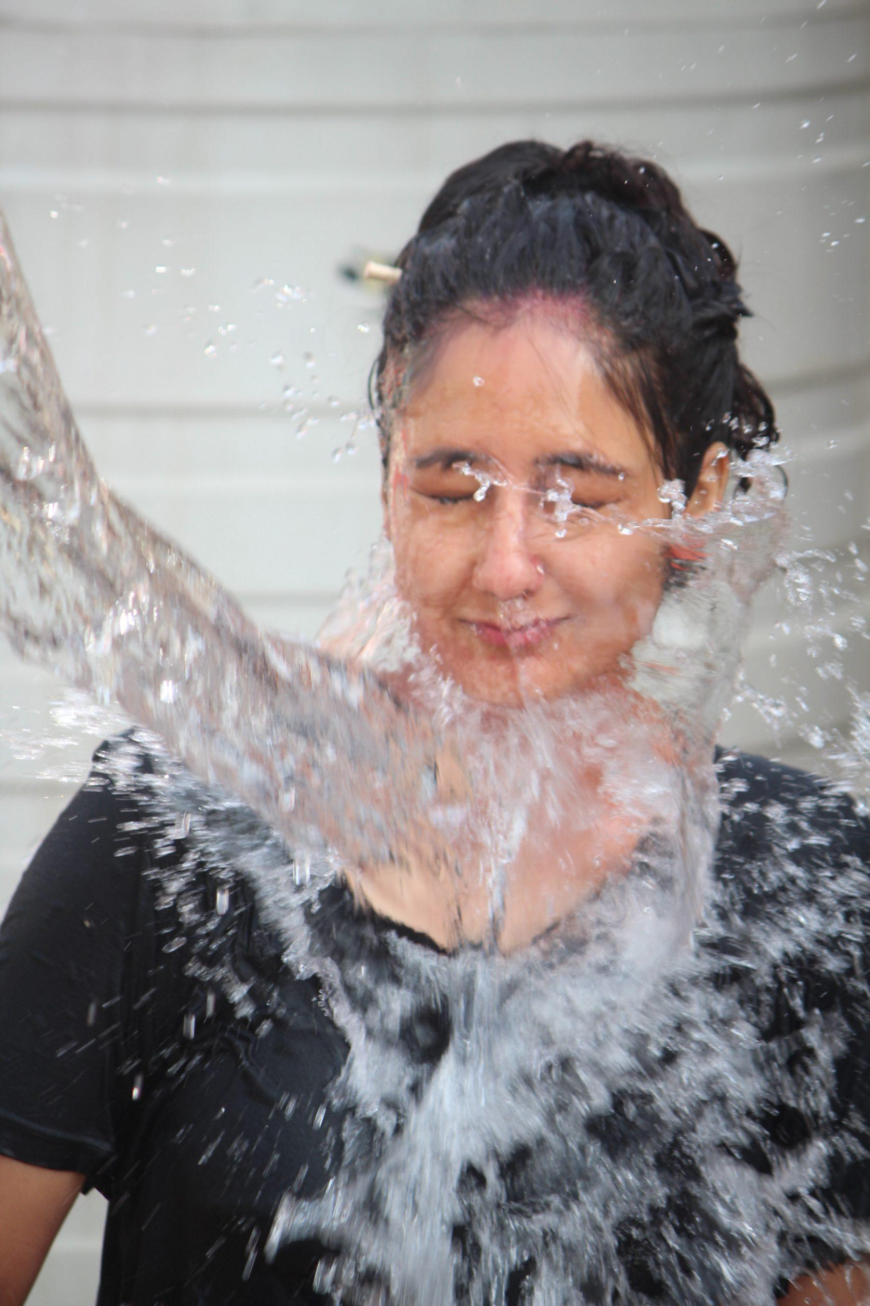 Splashing water on girls face