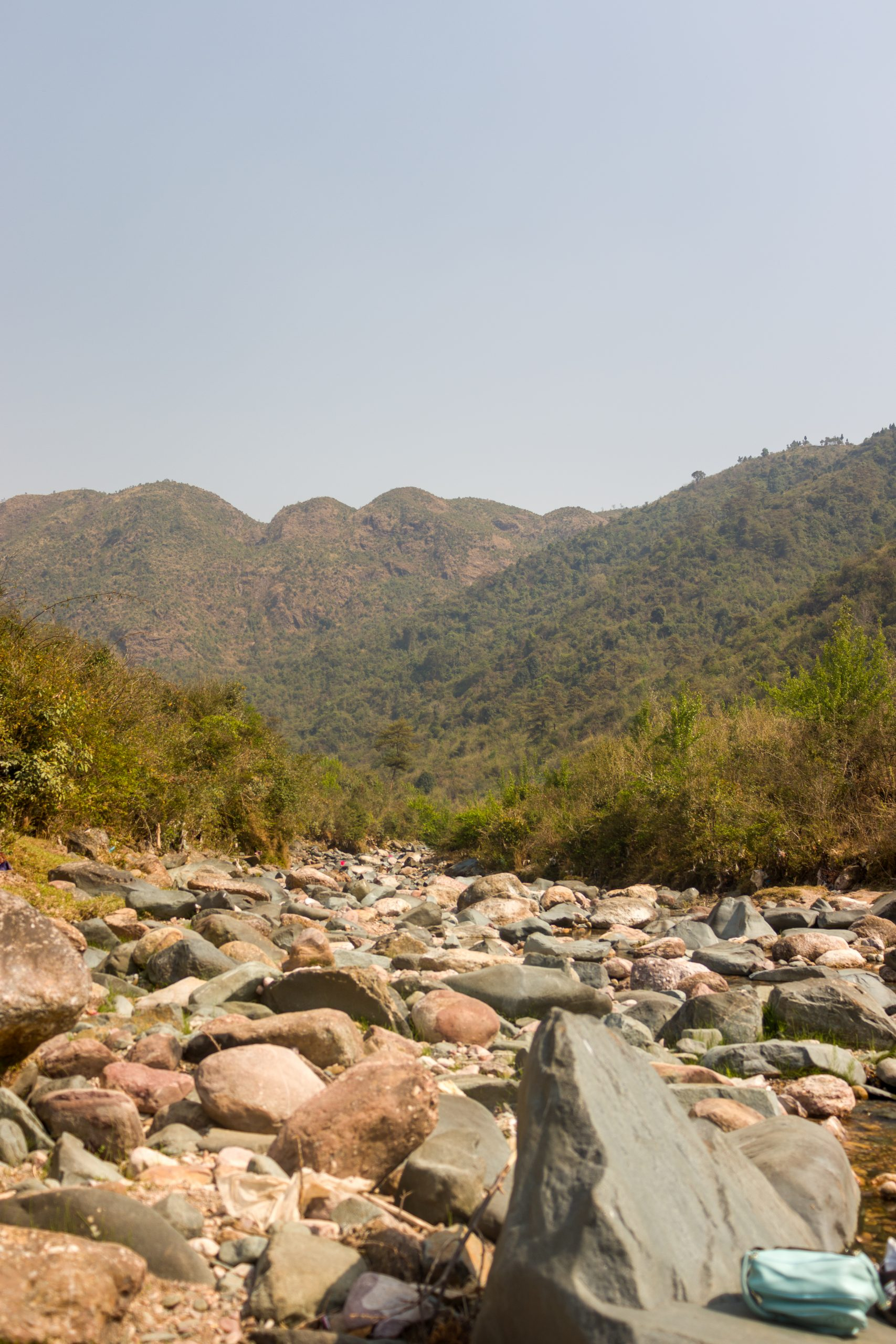 Stones in a dry river under mountains