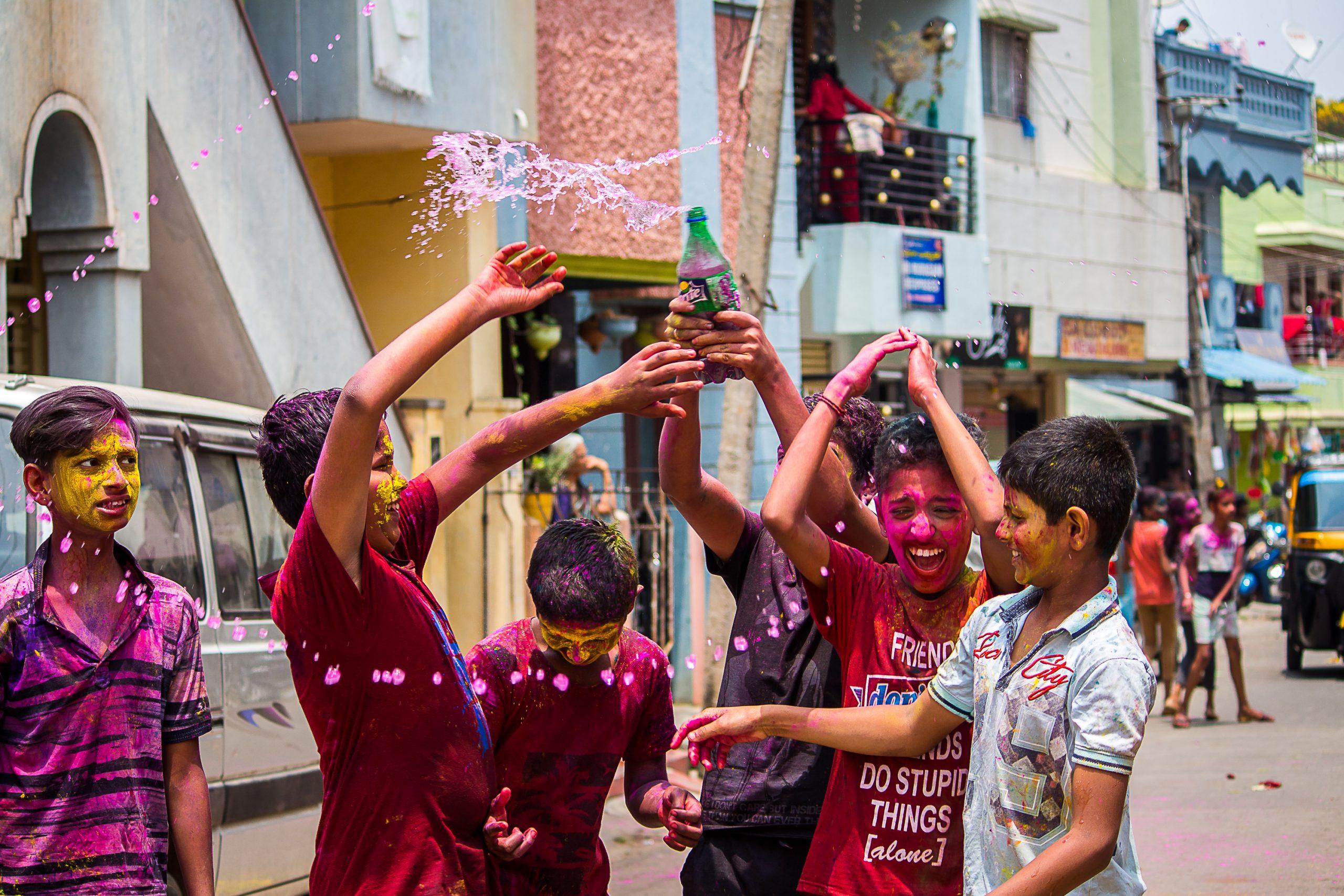 Street boys celebrating Holi festival