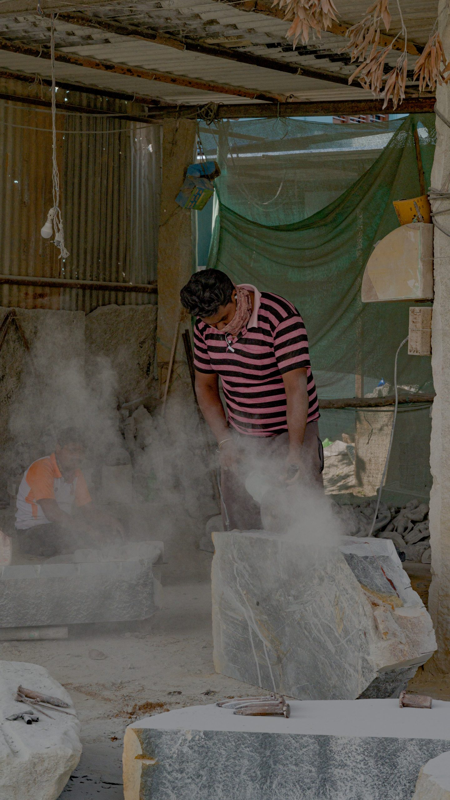 Man cutting marble stone