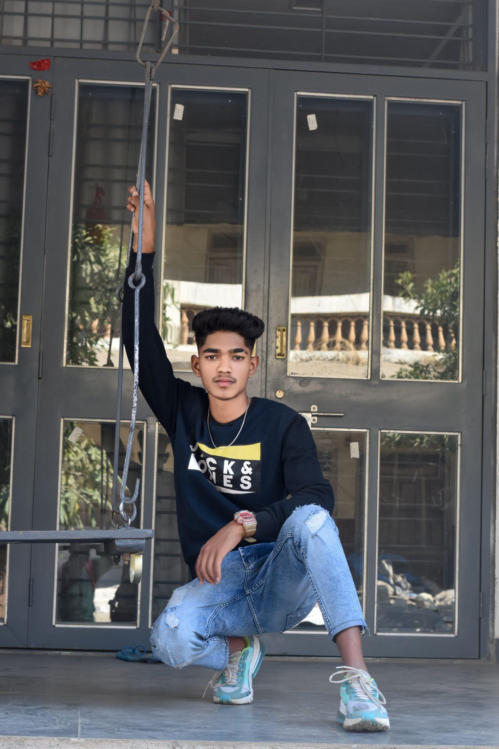 Stylish boy posing in front of door