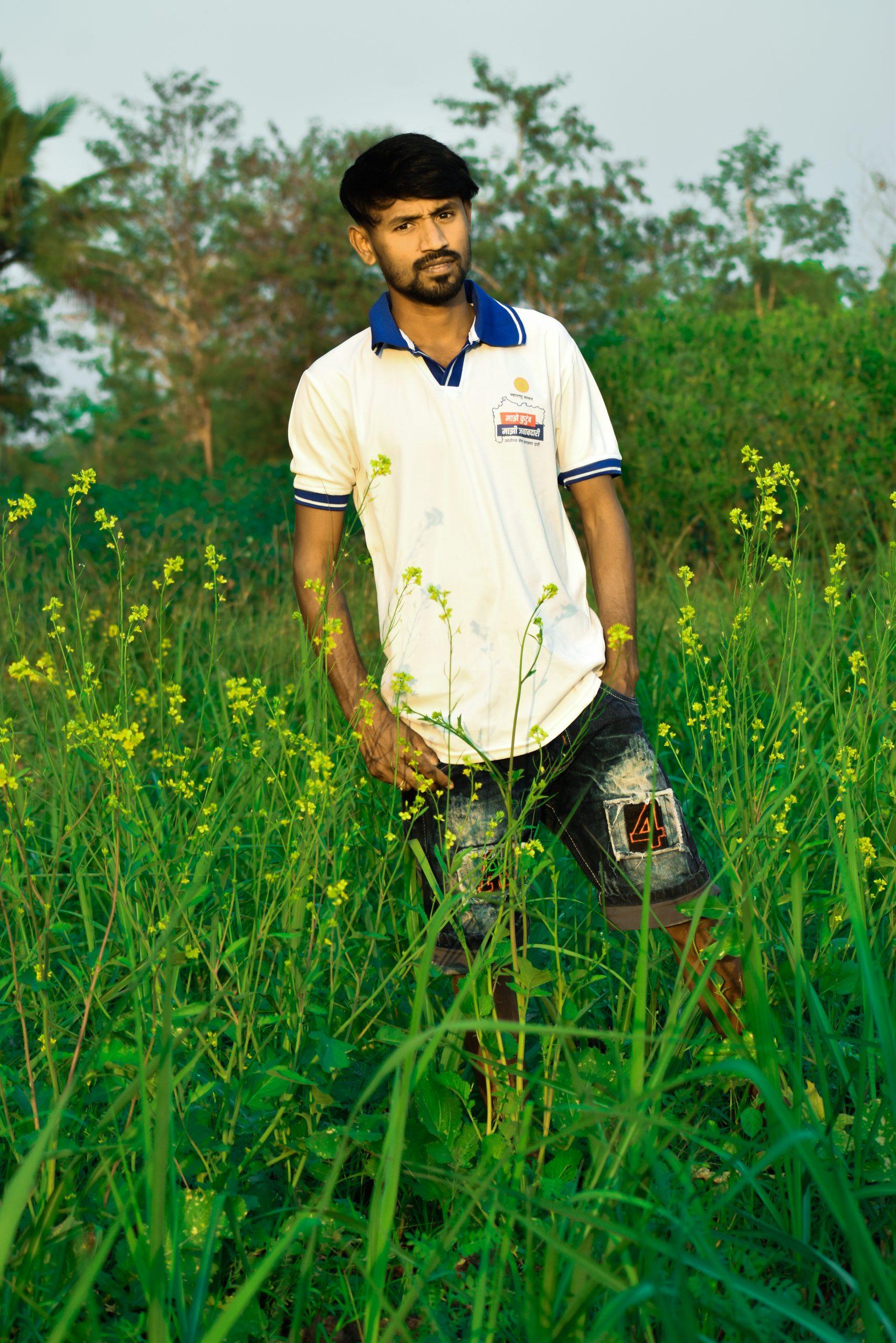 Stylish boy posing in the crop farm