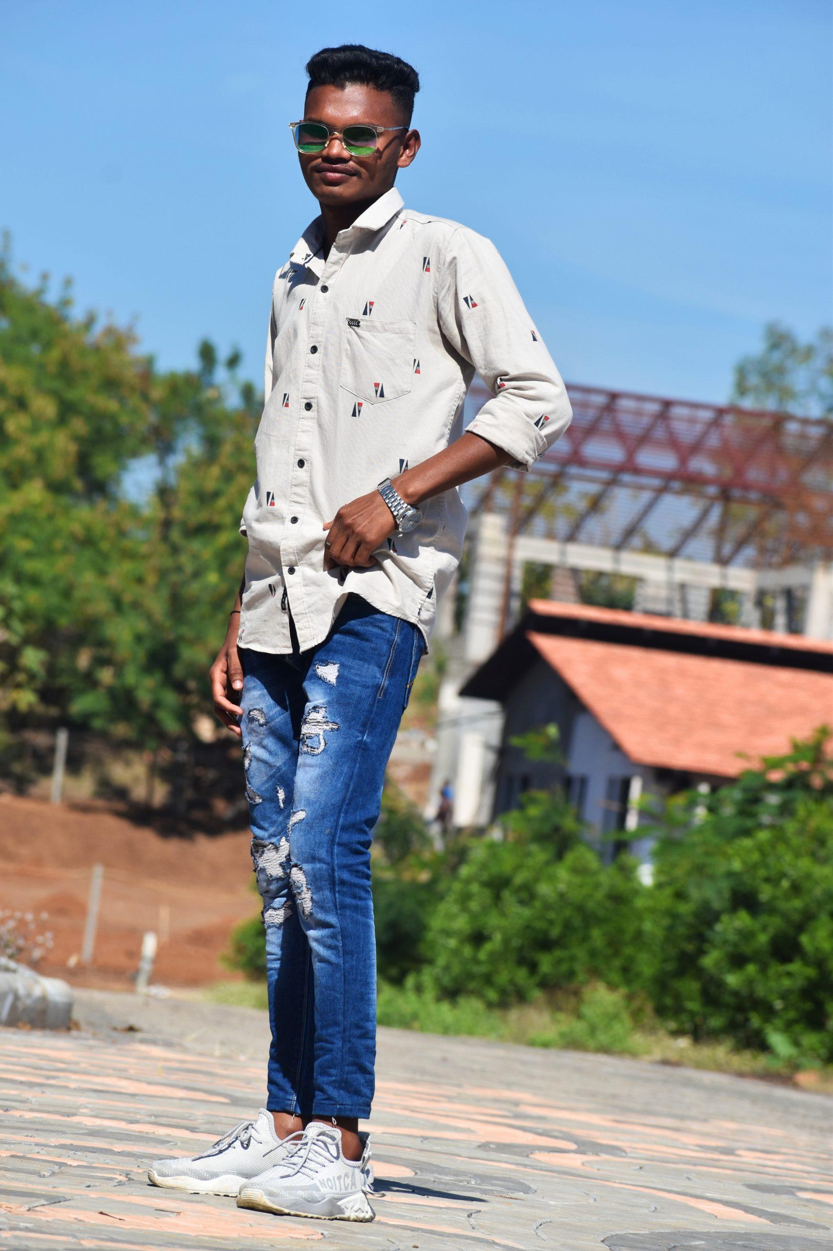 Stylish Boy posing in the garden
