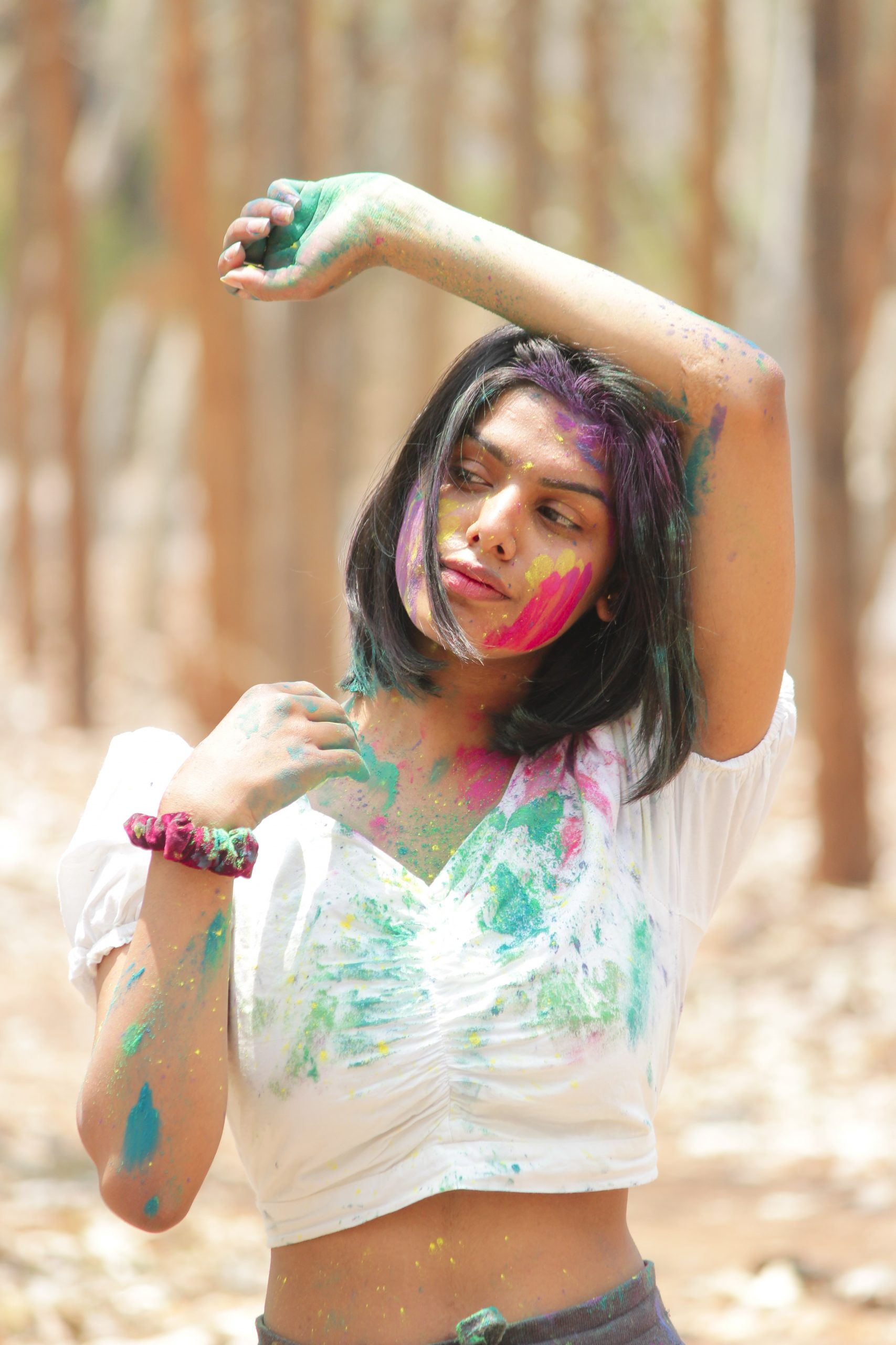 Stylish girl posing with Holi colors