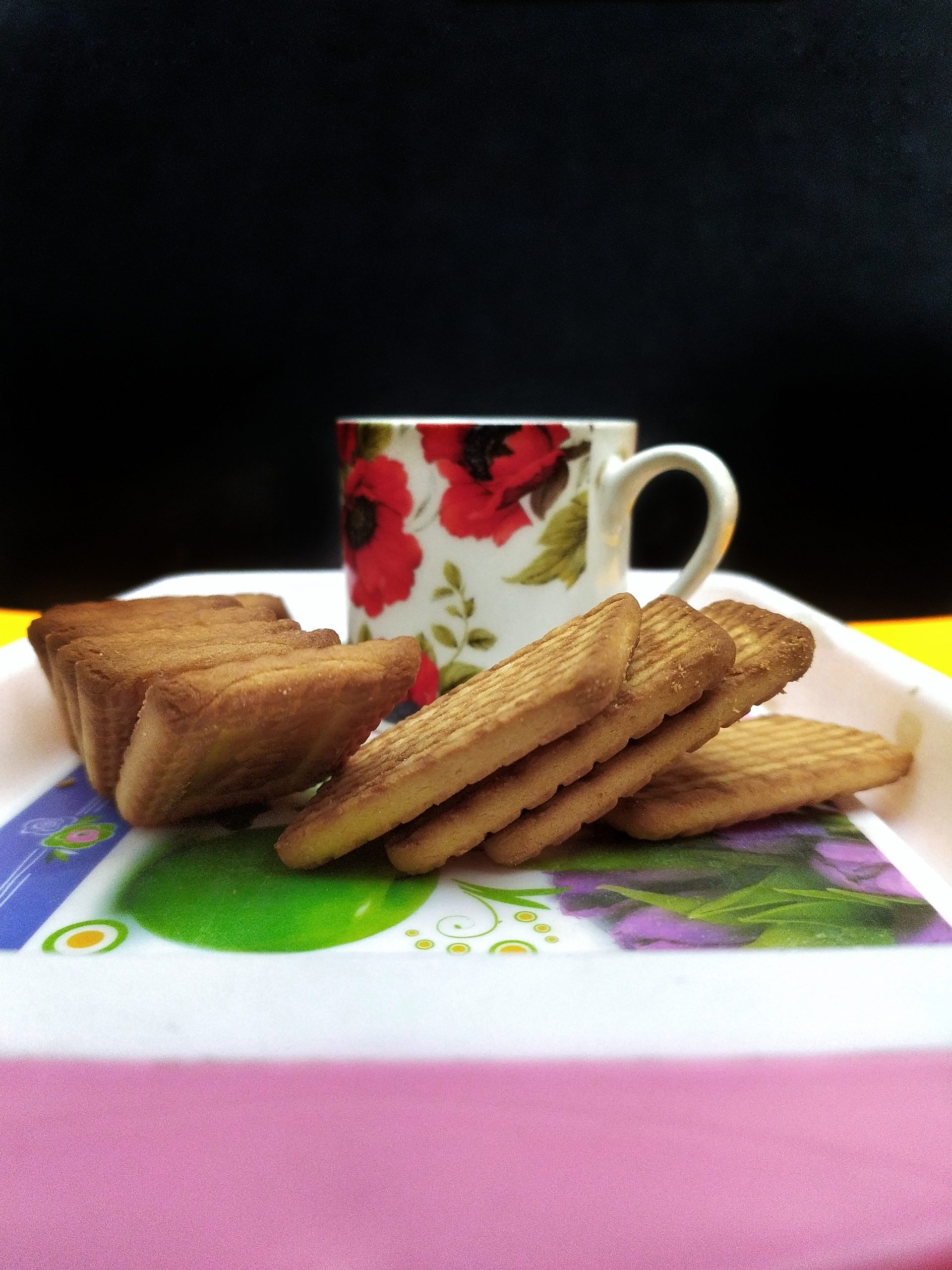 Tea cup with biscuits in tray