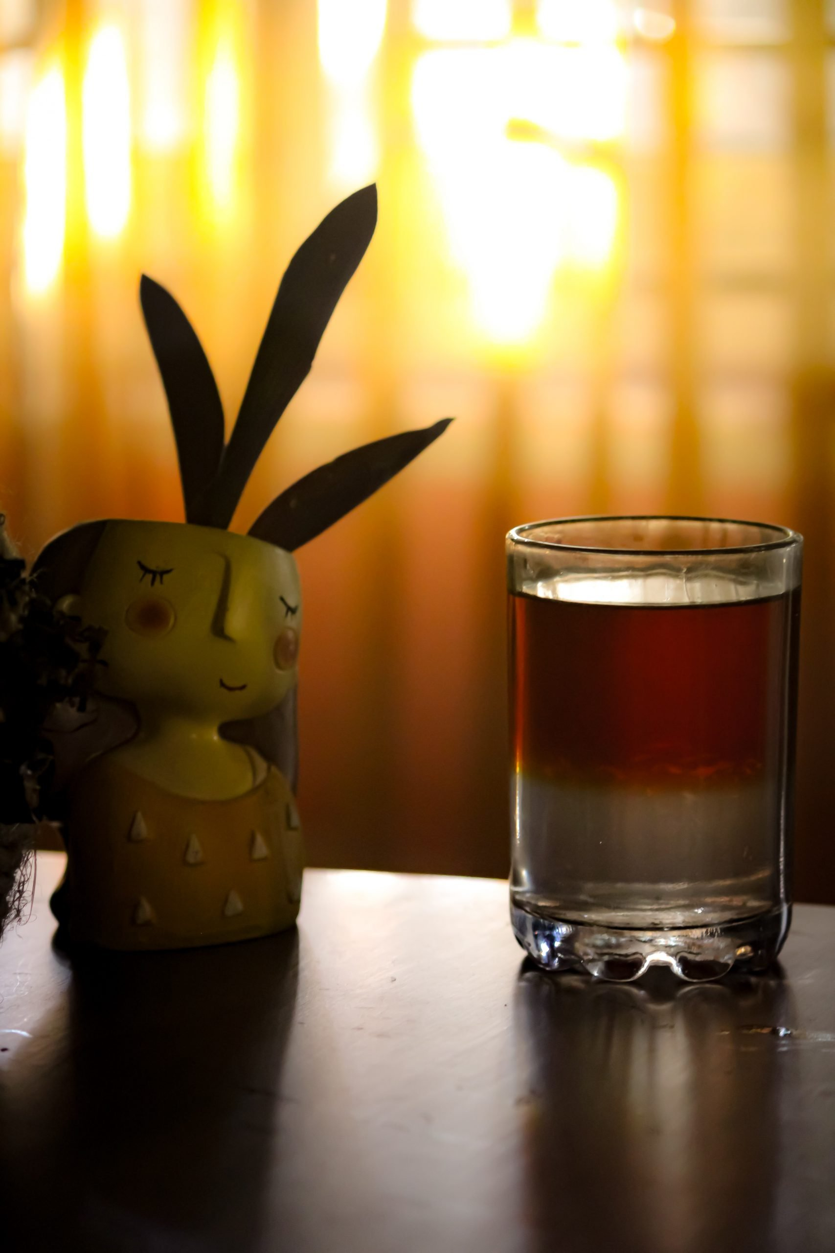Black tea in the glass with plant pot