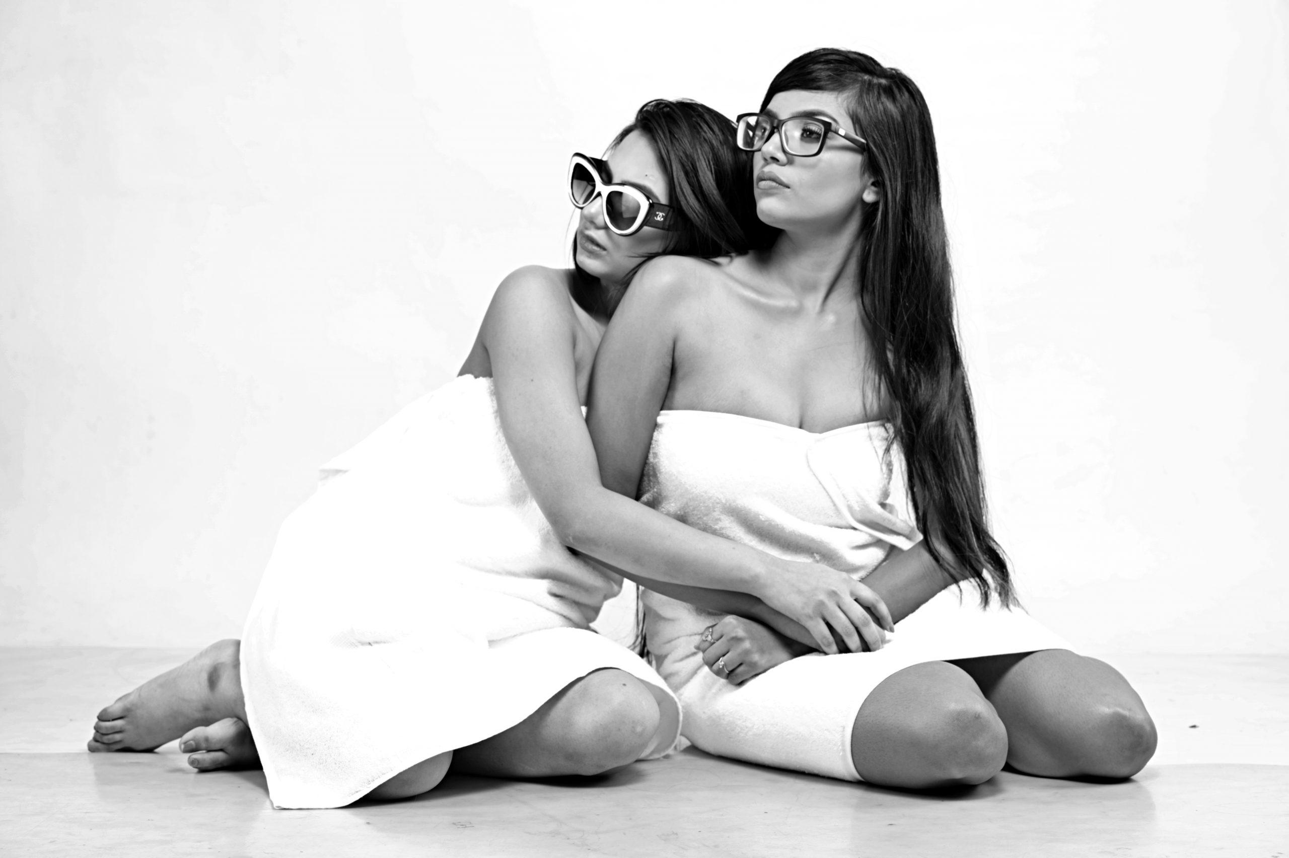 Two female models posing in Towel