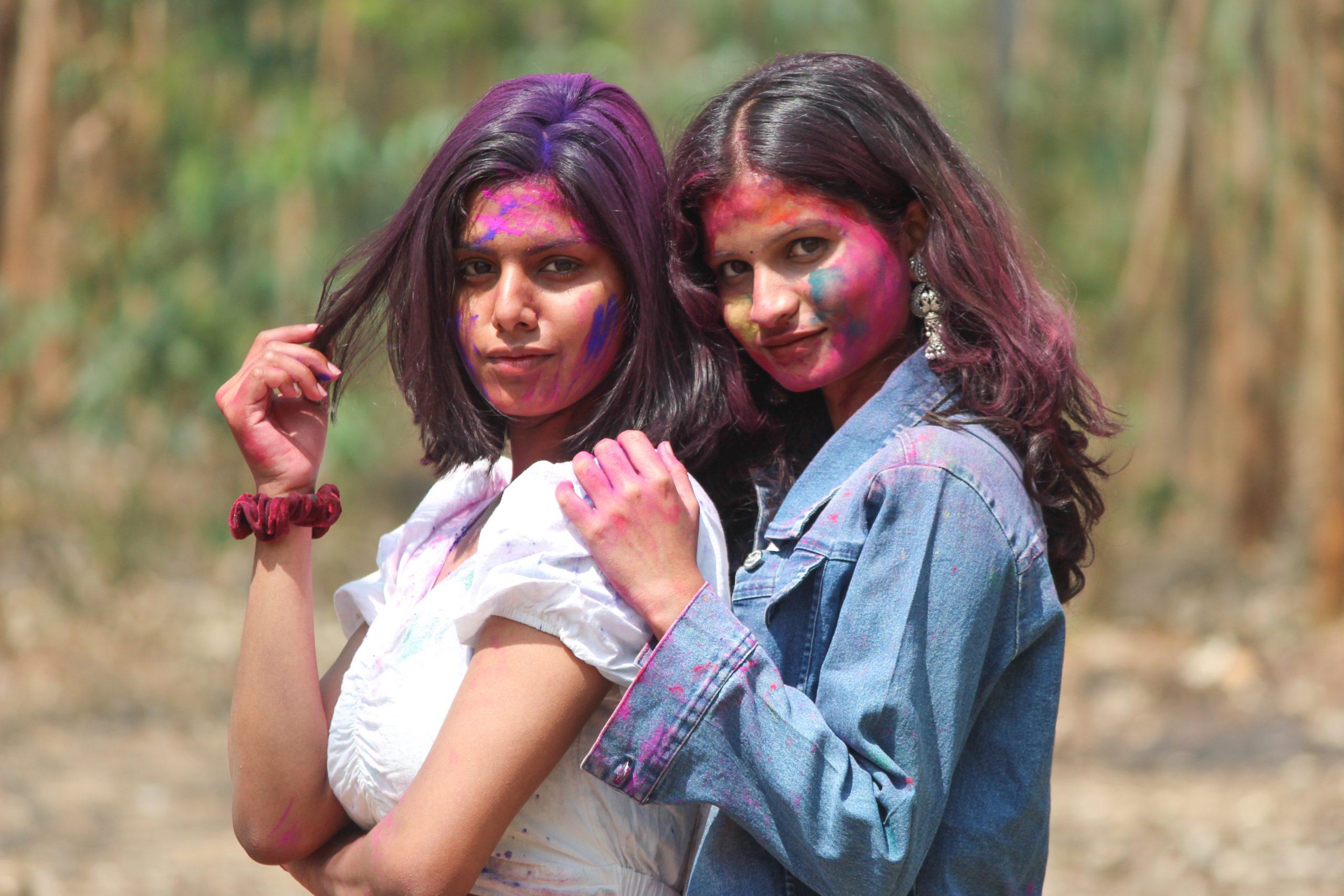 Two girls enjoying Holi festival