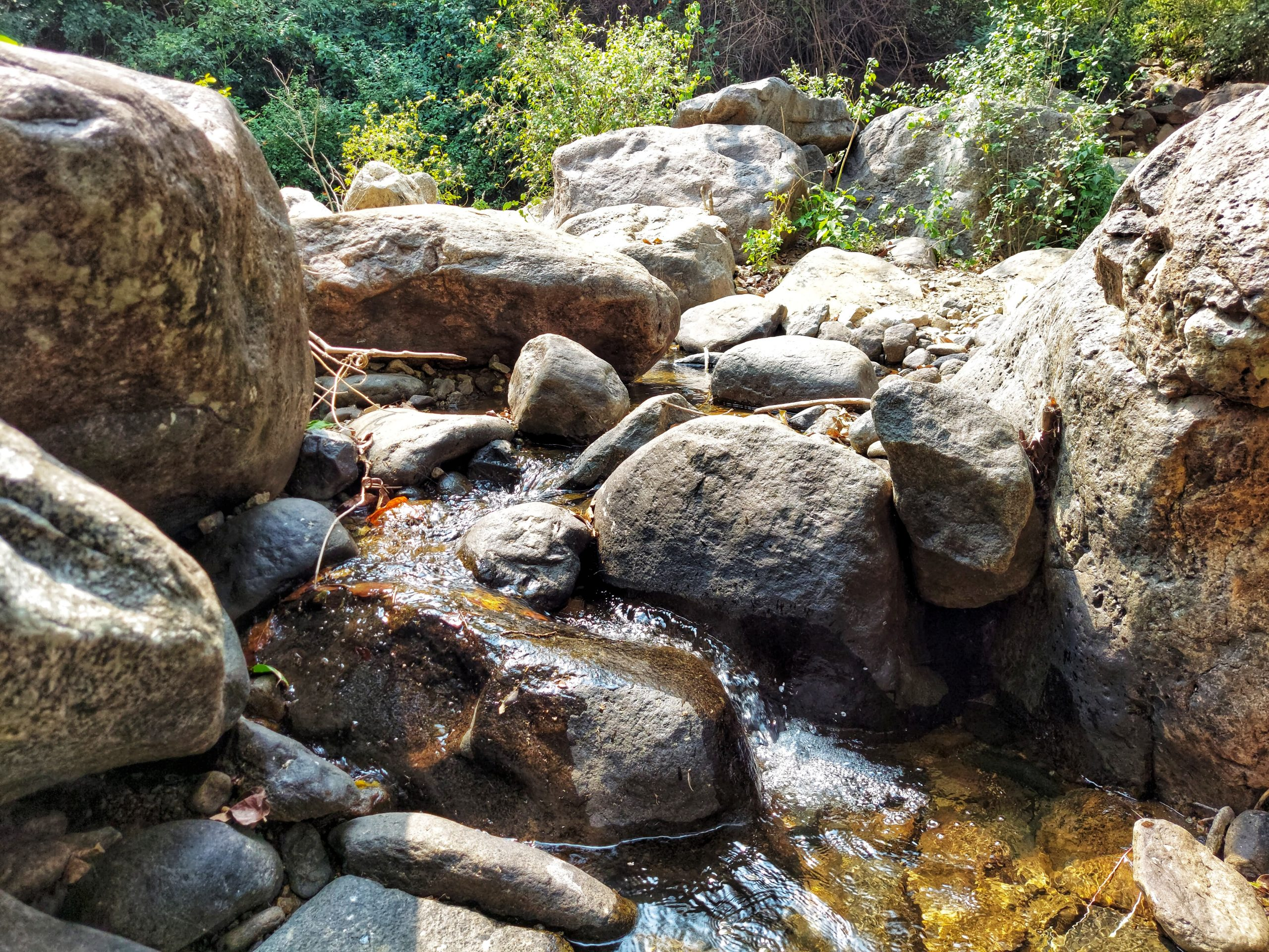 Water flowing through big stones