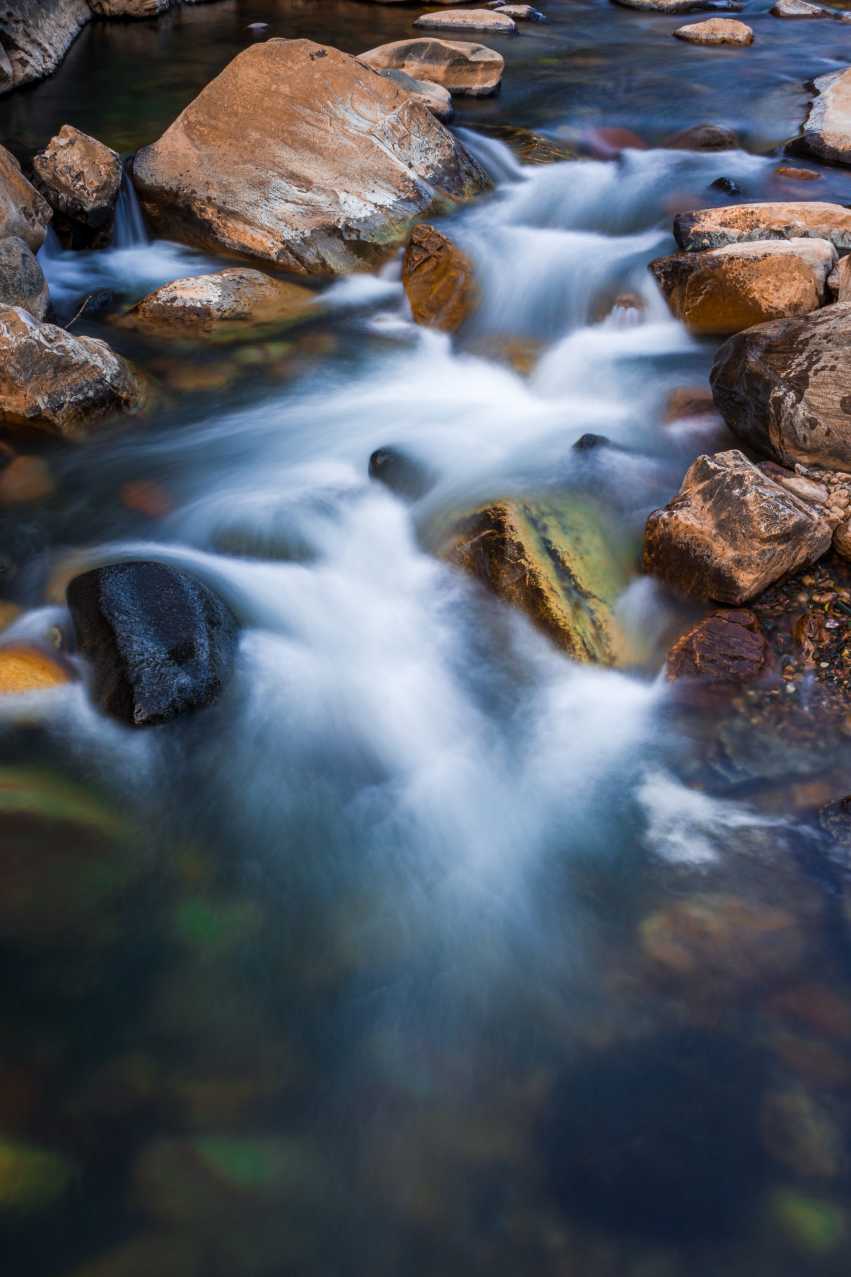 Portrait of a water flowing through the rocks