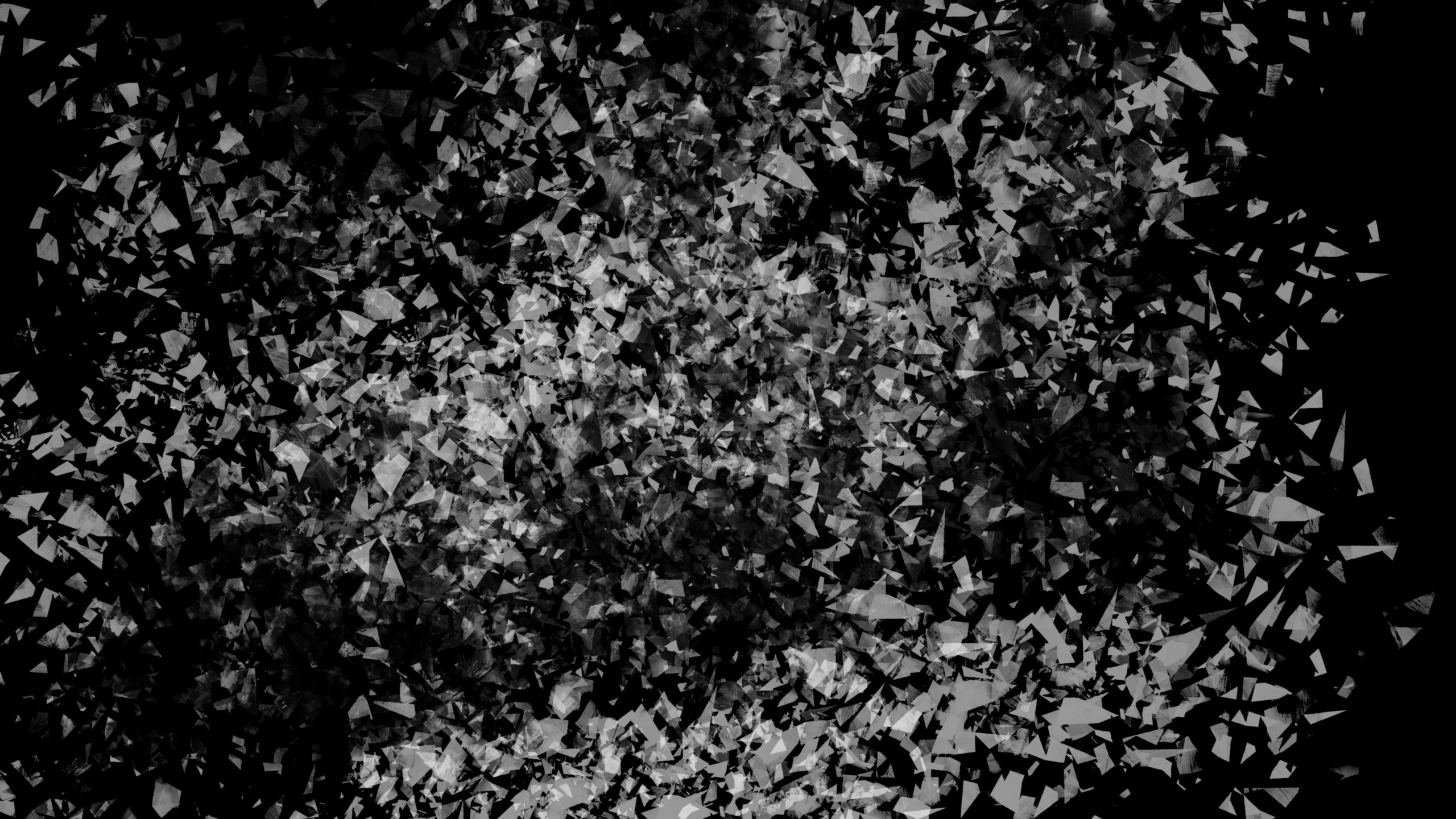 White chips on a black surface wallpaper
