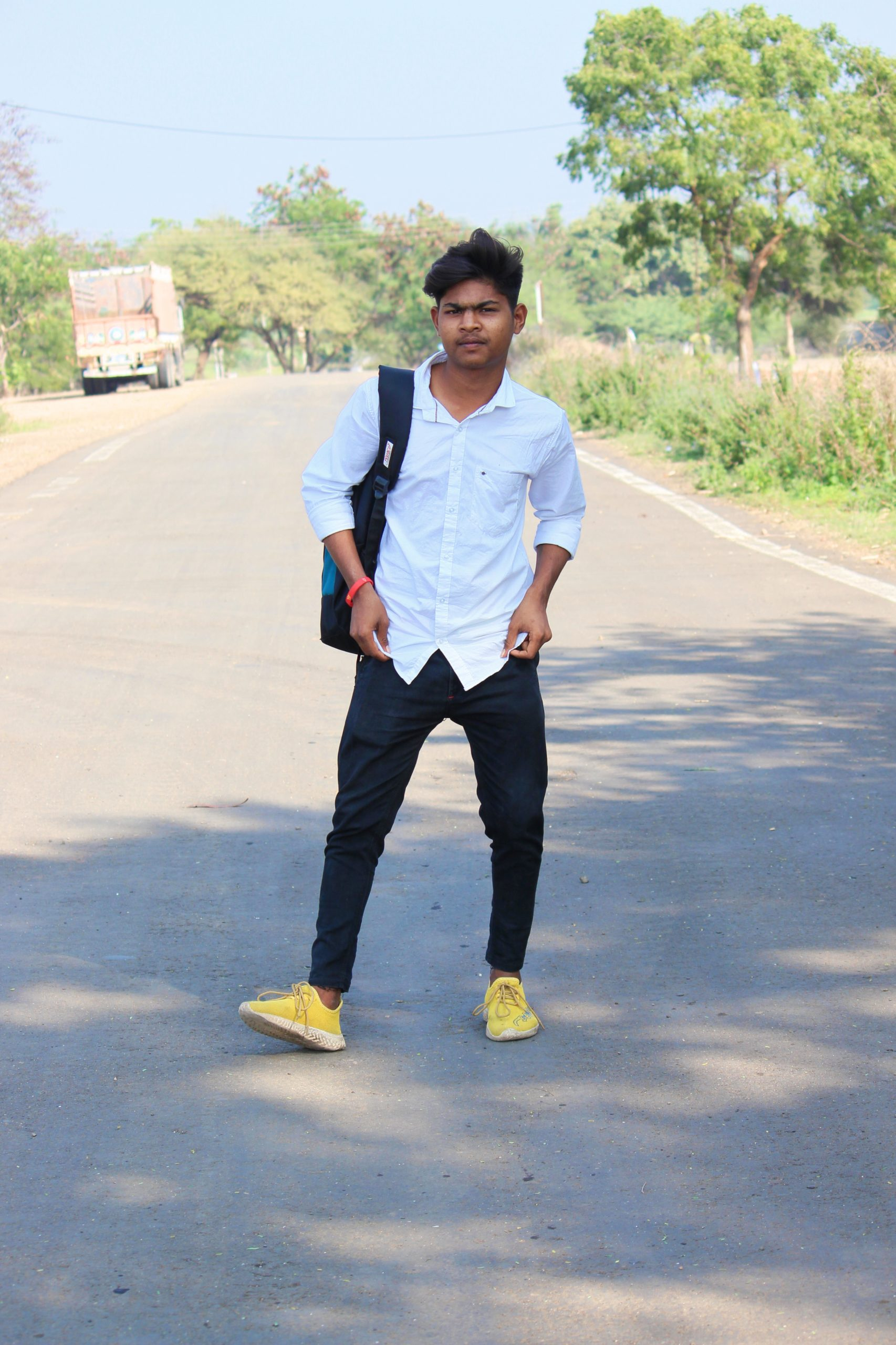 Young Indian boy posing on the road