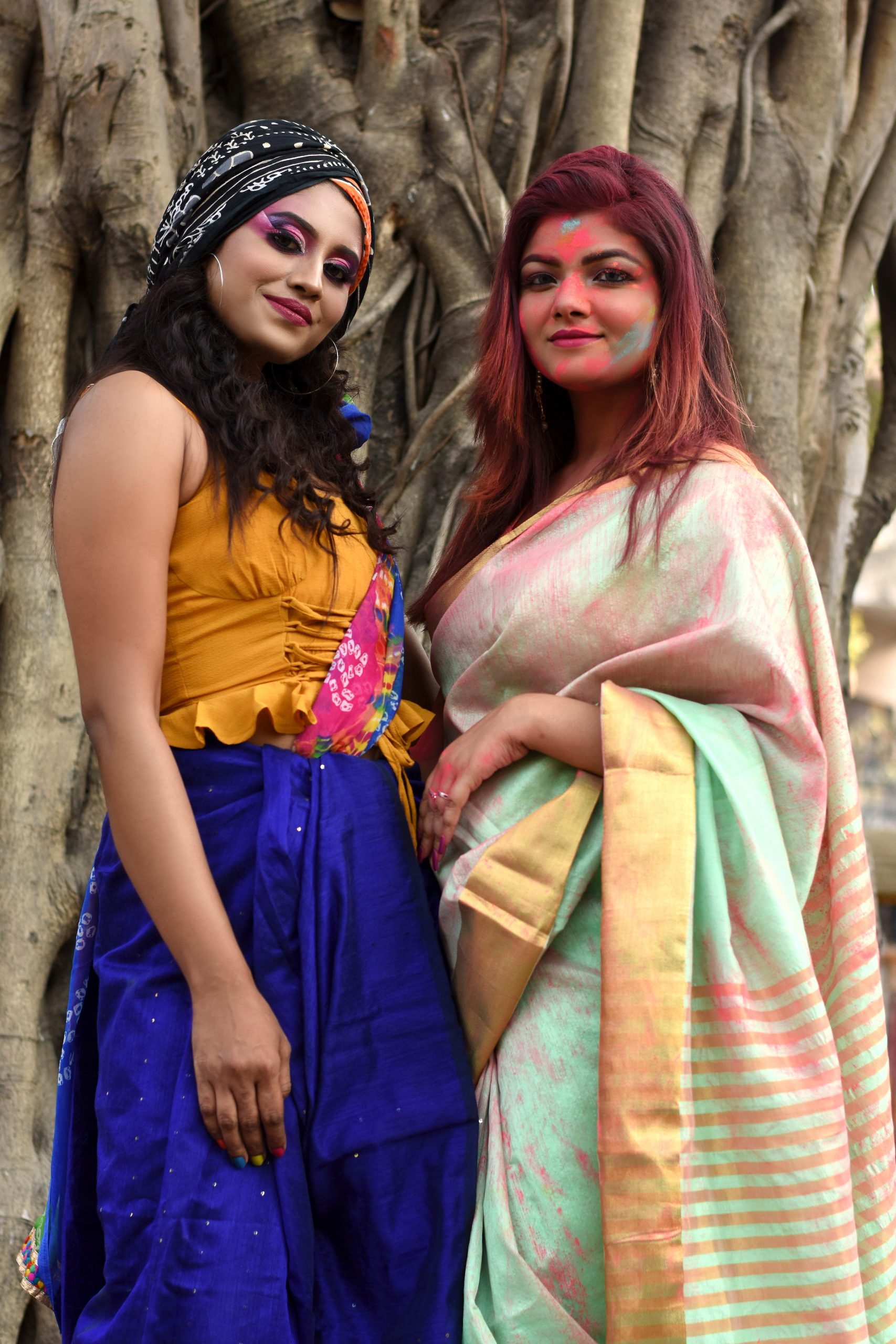 beautiful girls with Holi colors on their faces