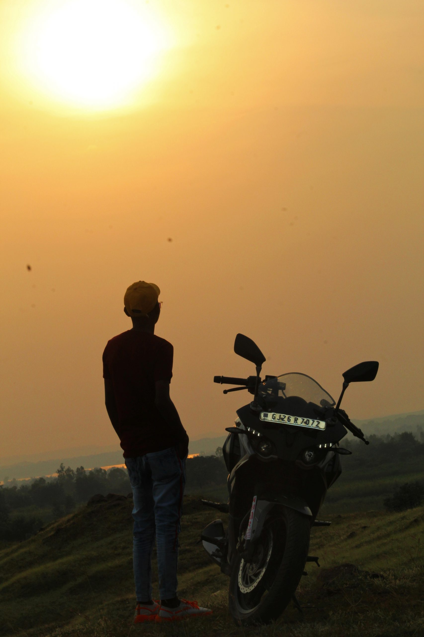 boy posing near a bike