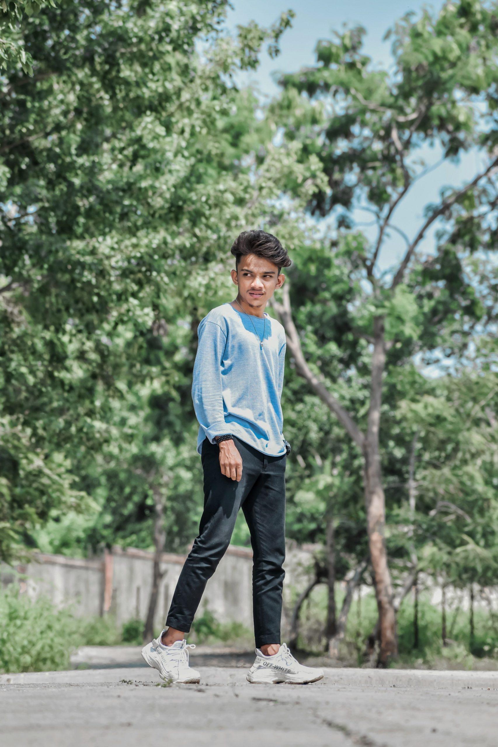 boy posing on a road