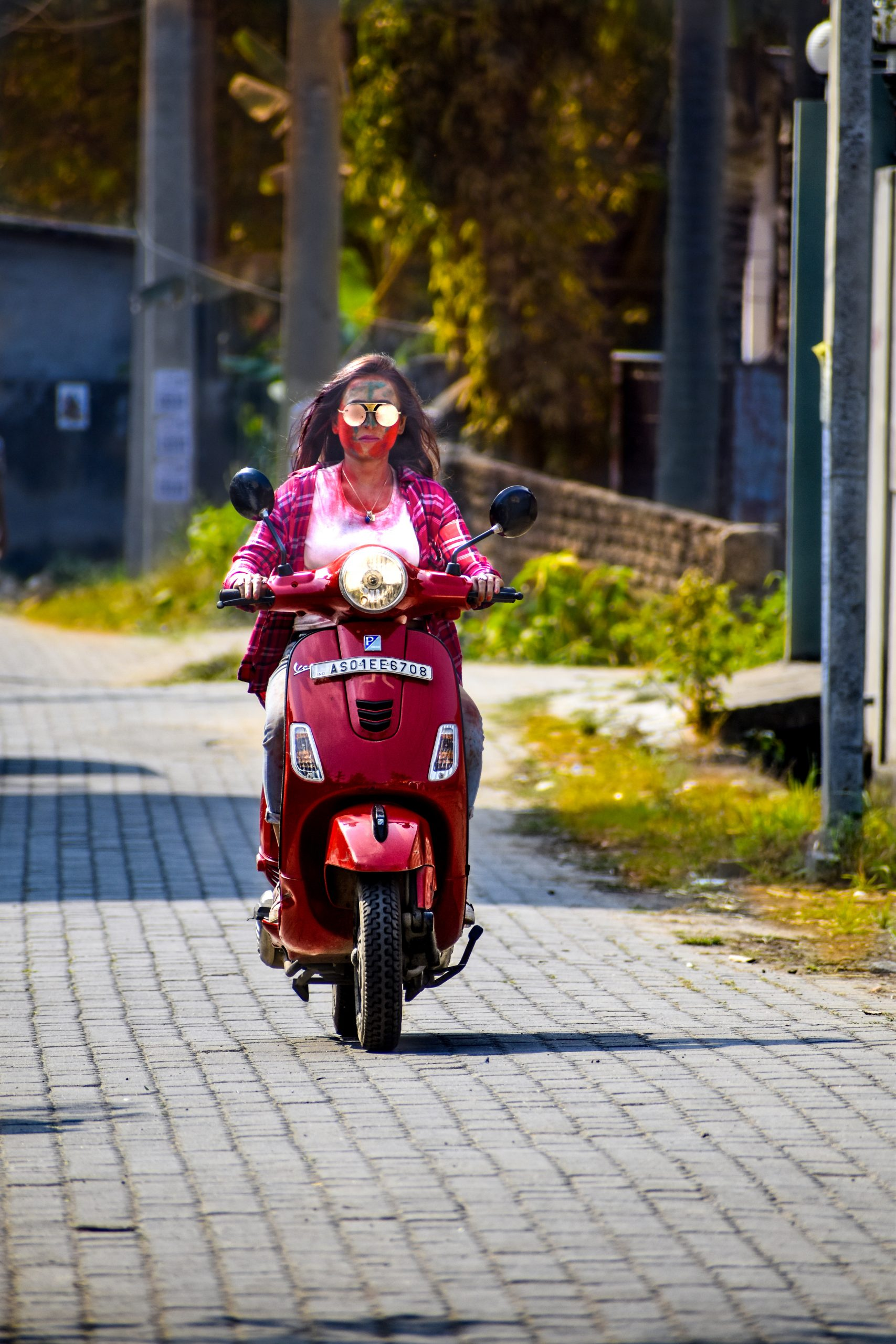 A girl driving a scooter