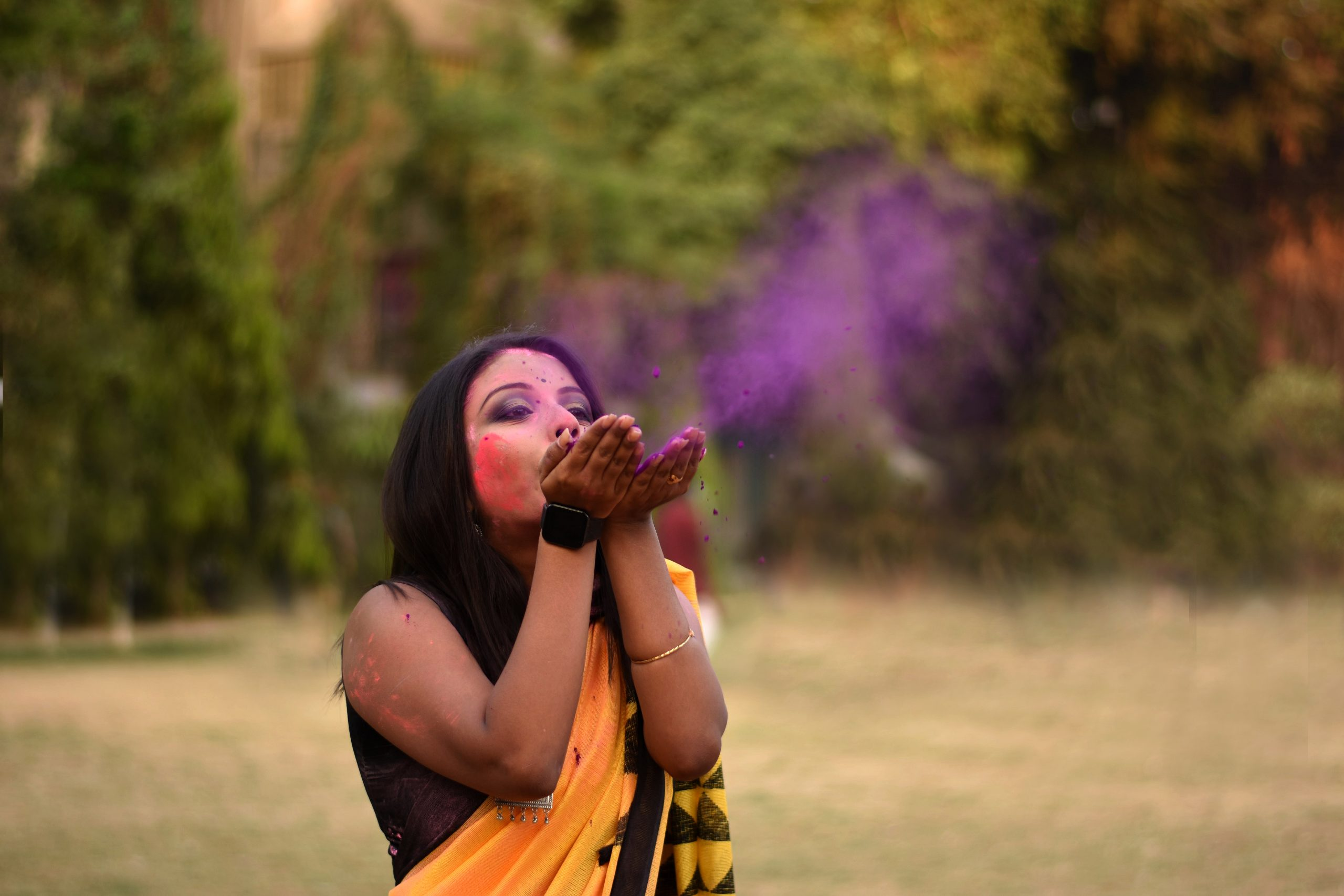 Beautiful girl playing with Holi colors