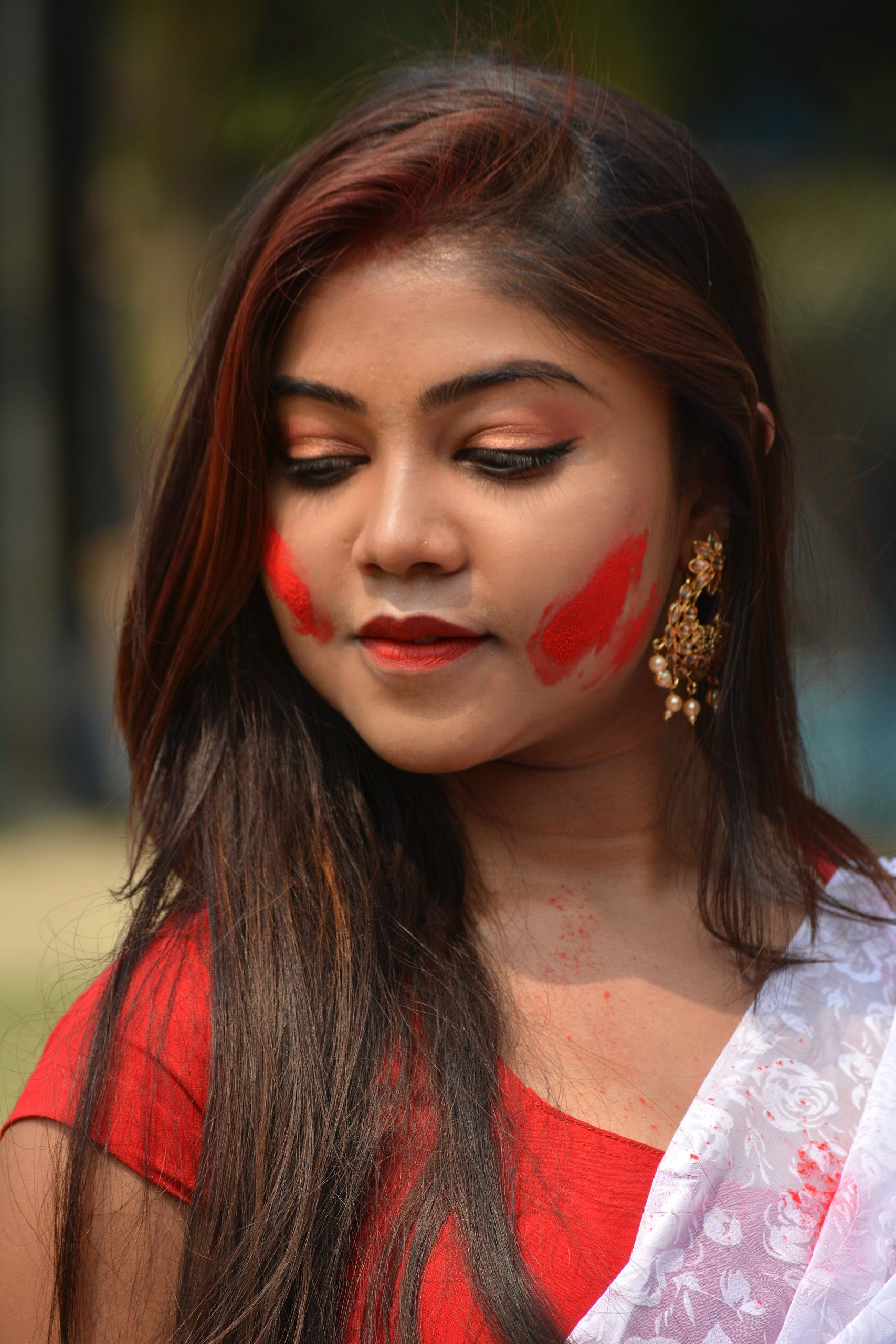 Beautiful girl with Holi color on her face