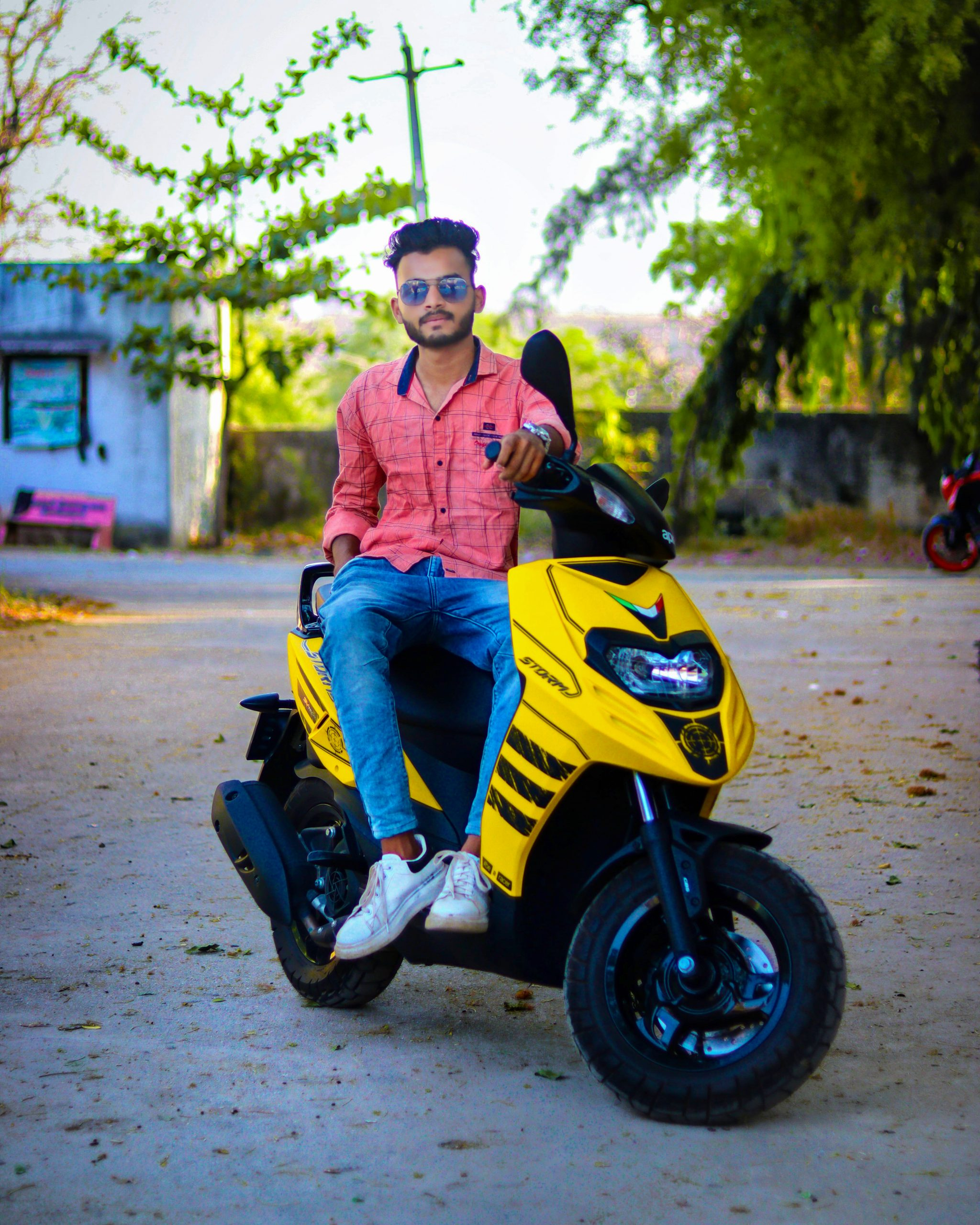 Boy posing on scooty