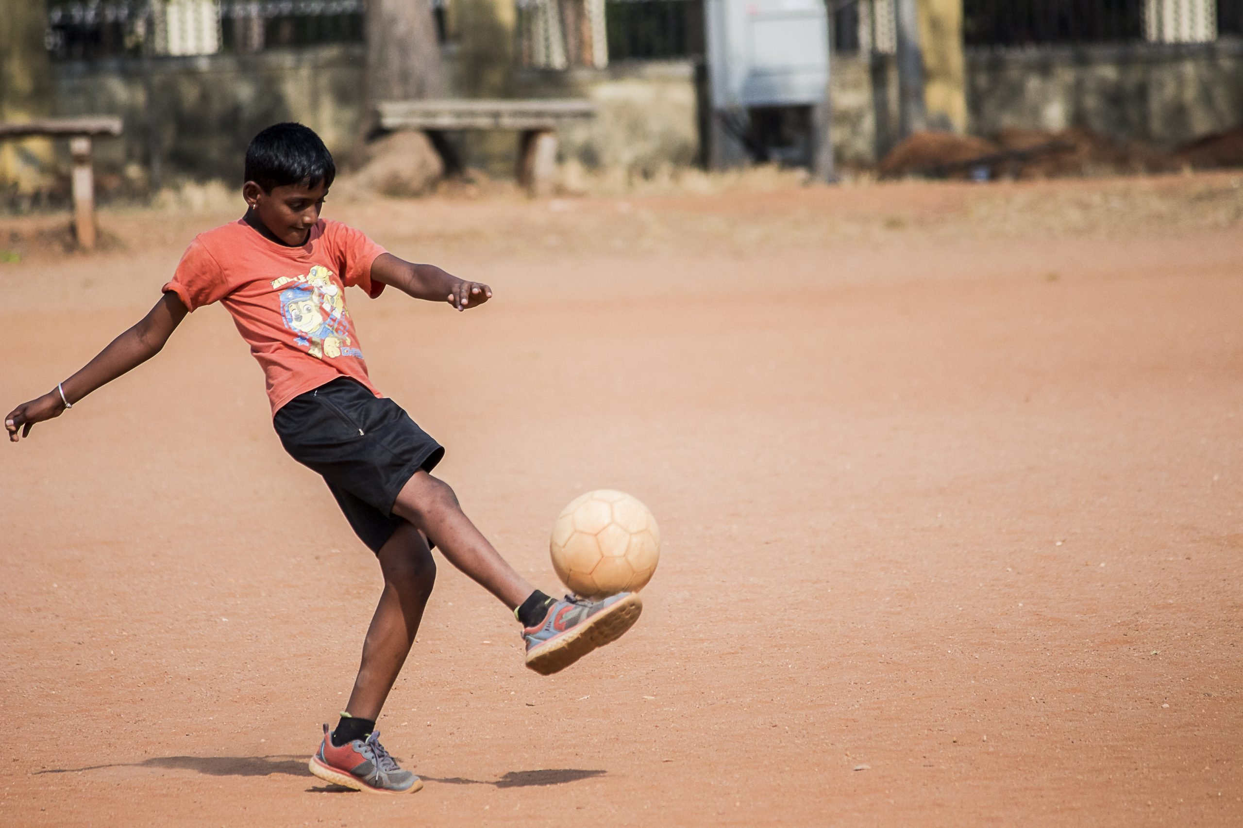 A Boy Playing Football