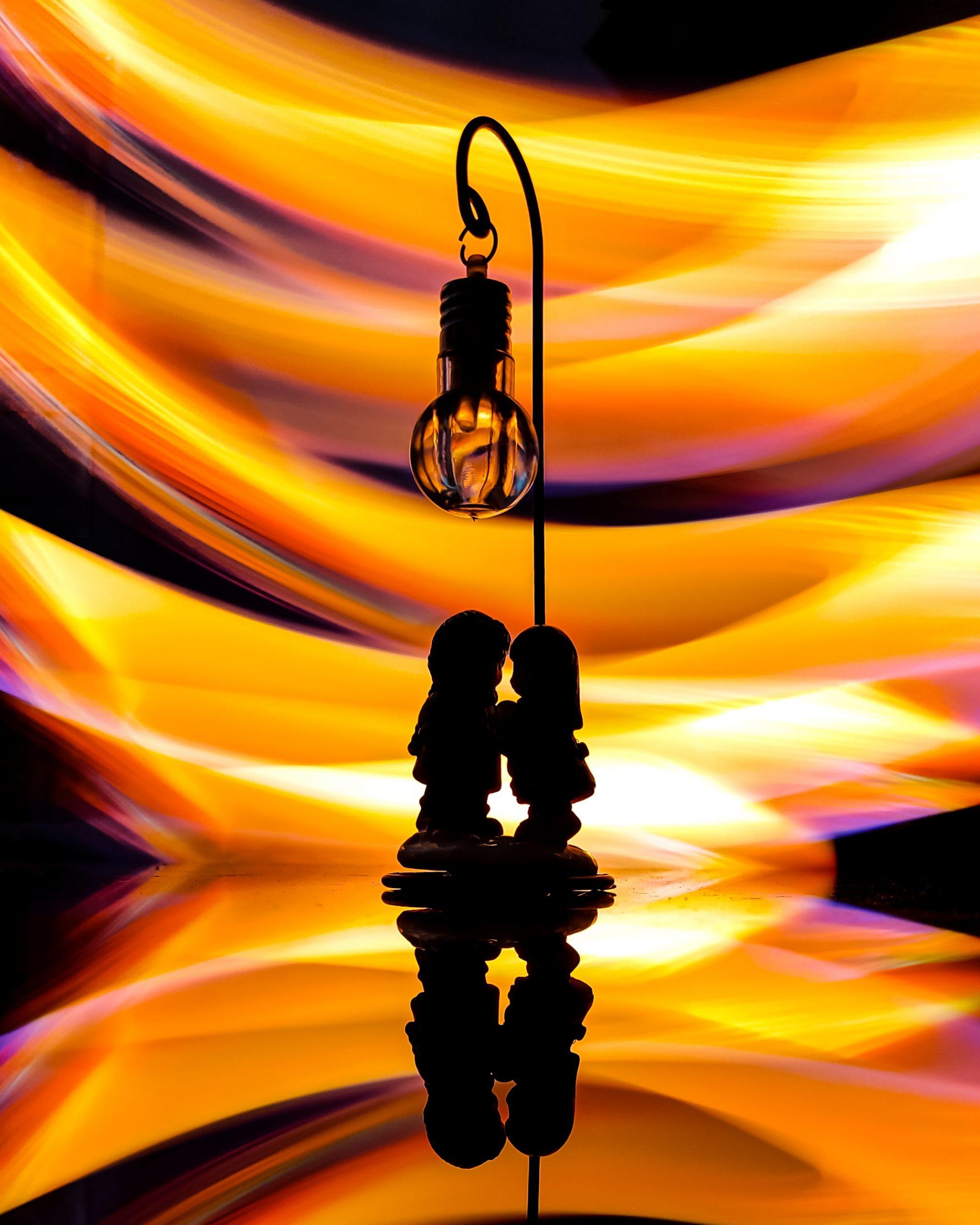 A couple under a light pole illustration
