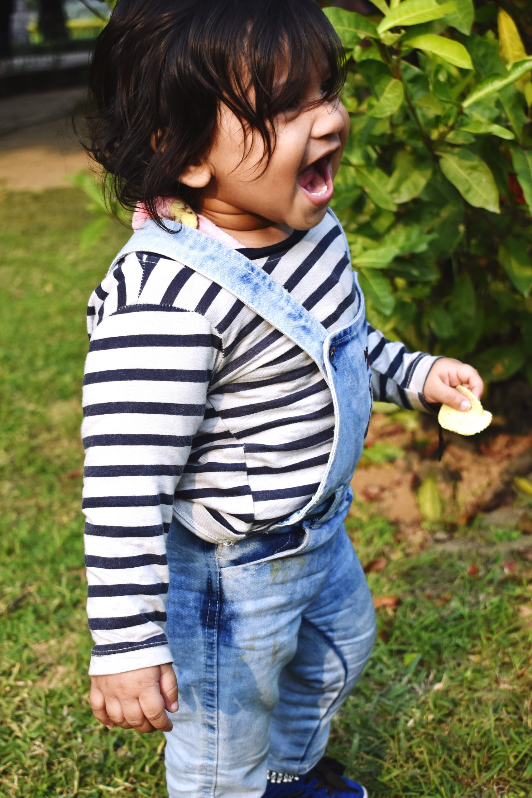 A kid in a garden