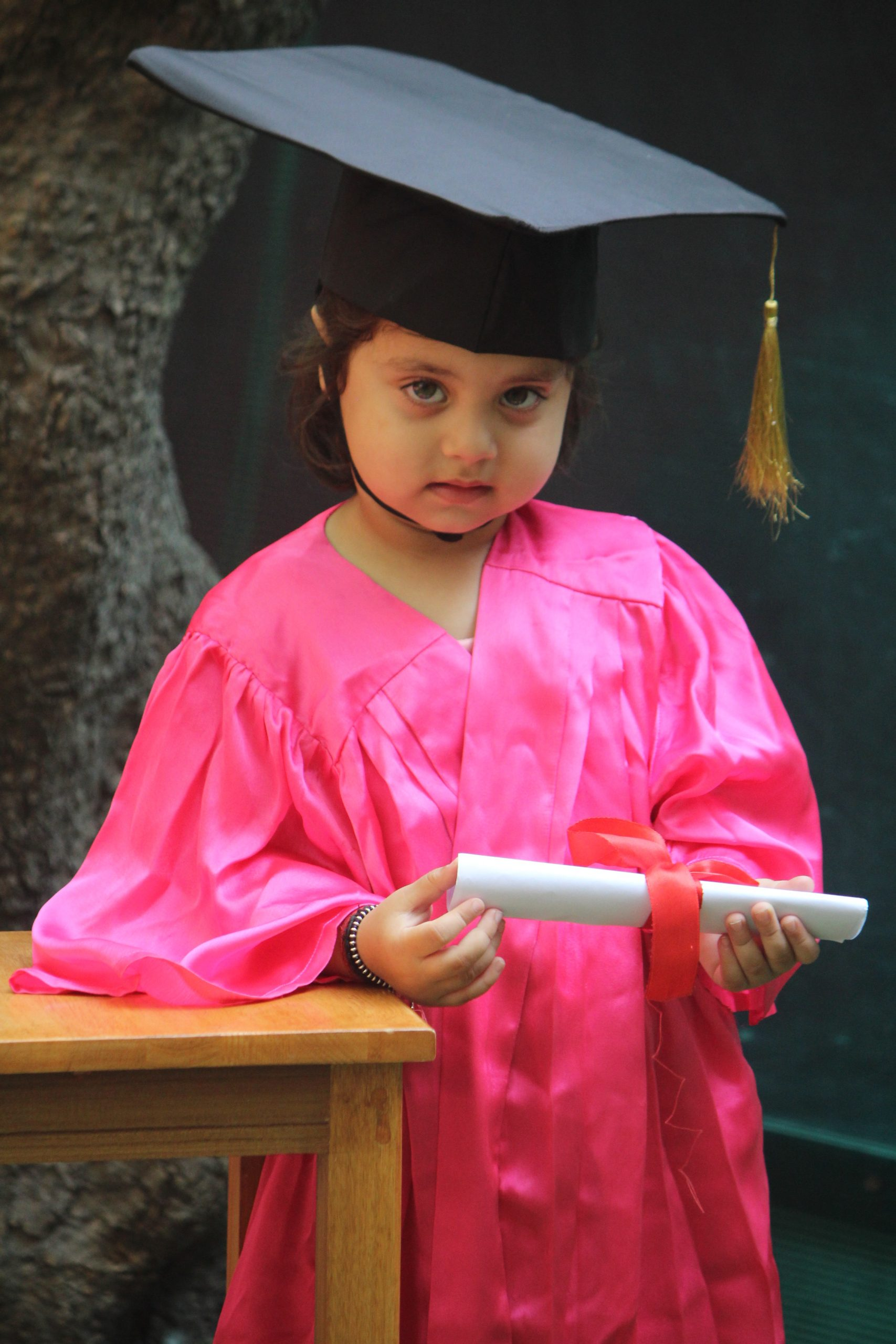 A kid in graduation day getup