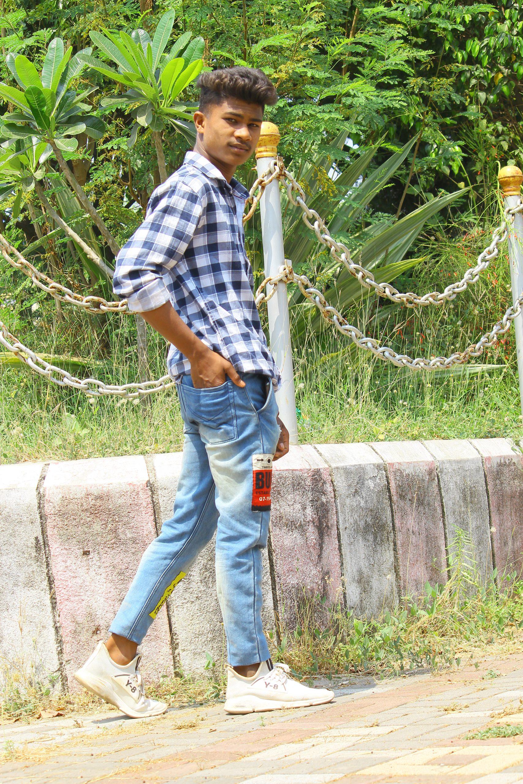A stylish boy posing near the garden