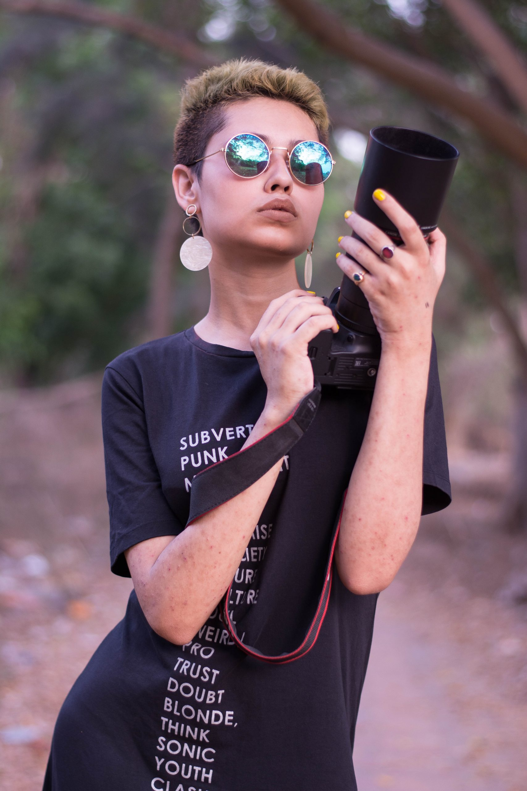 A stylish girl with a camera