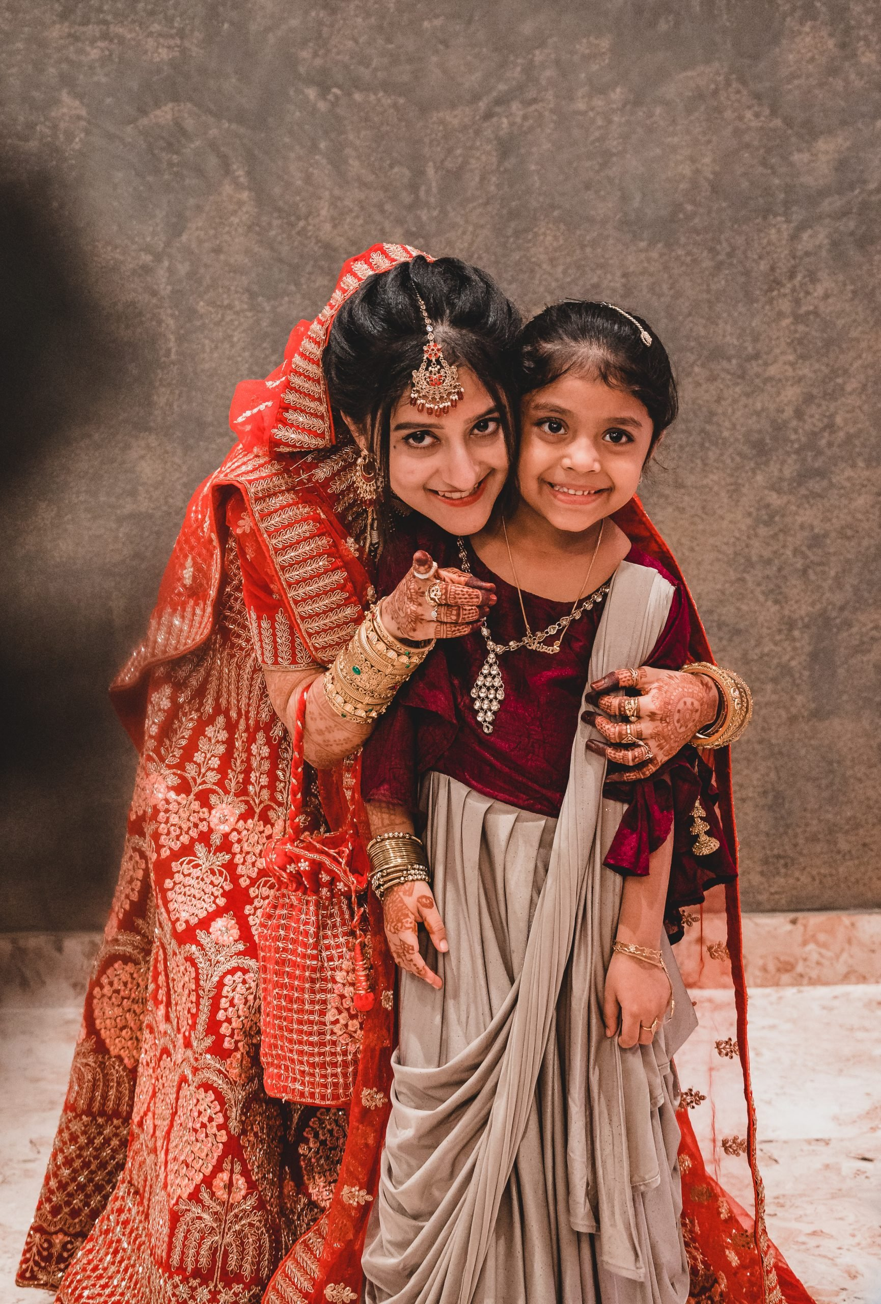 An Indian bride with a little girl