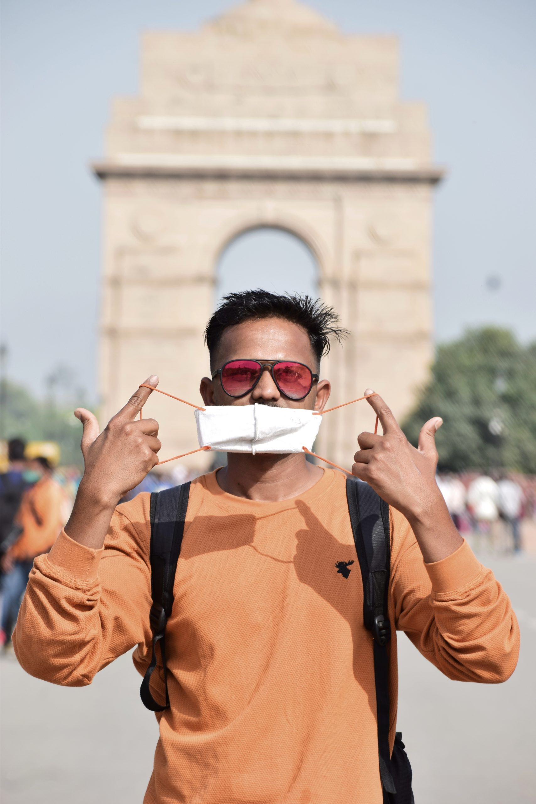 Boy posing in front of India gate