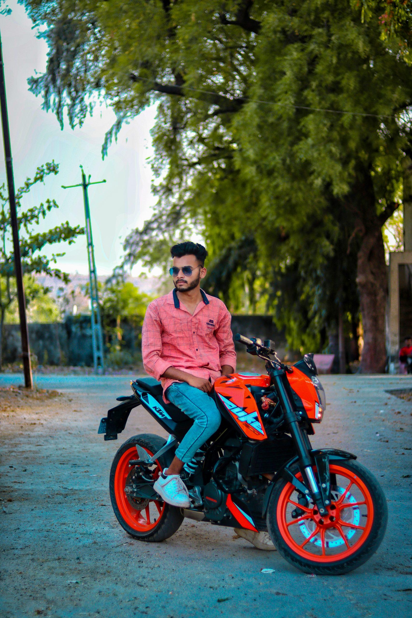 Boy posing on Duke bike