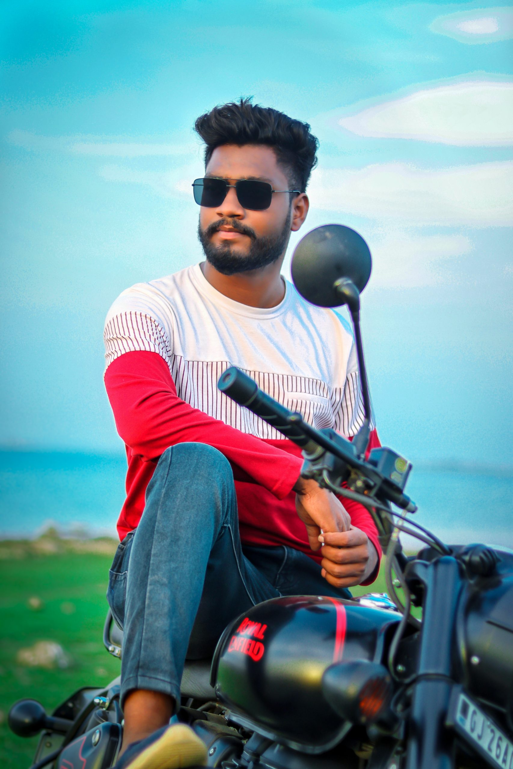 Boy posing on Royal Enfield bike