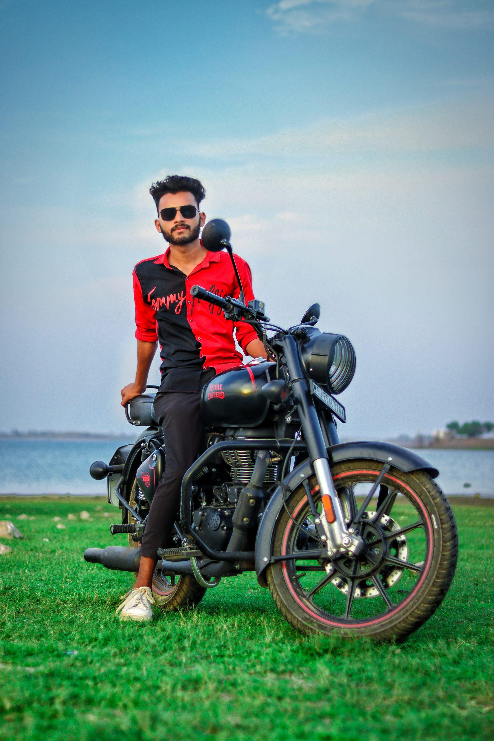 Boy posing on Royal Enfield bike