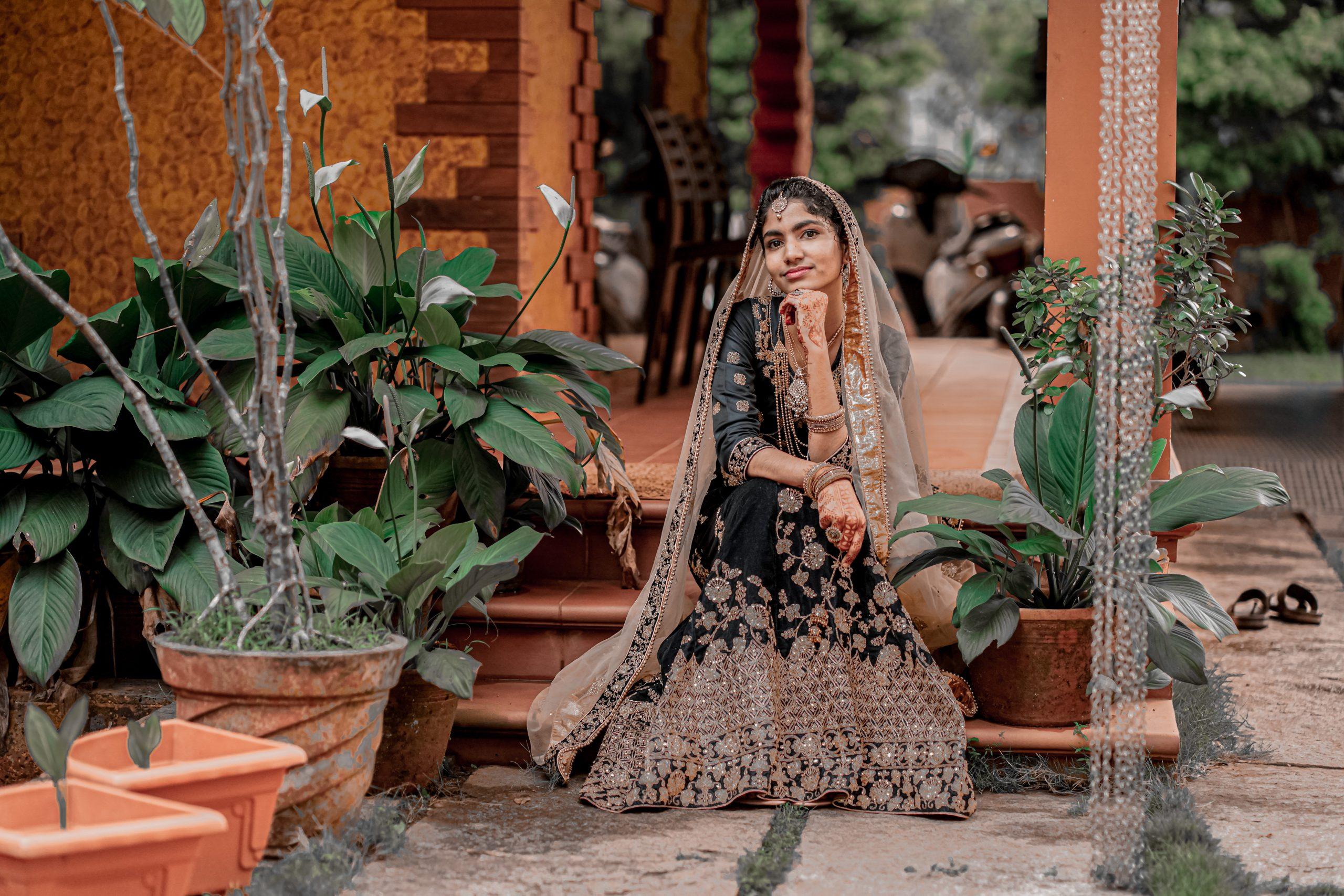 A girl sitting in a house garden