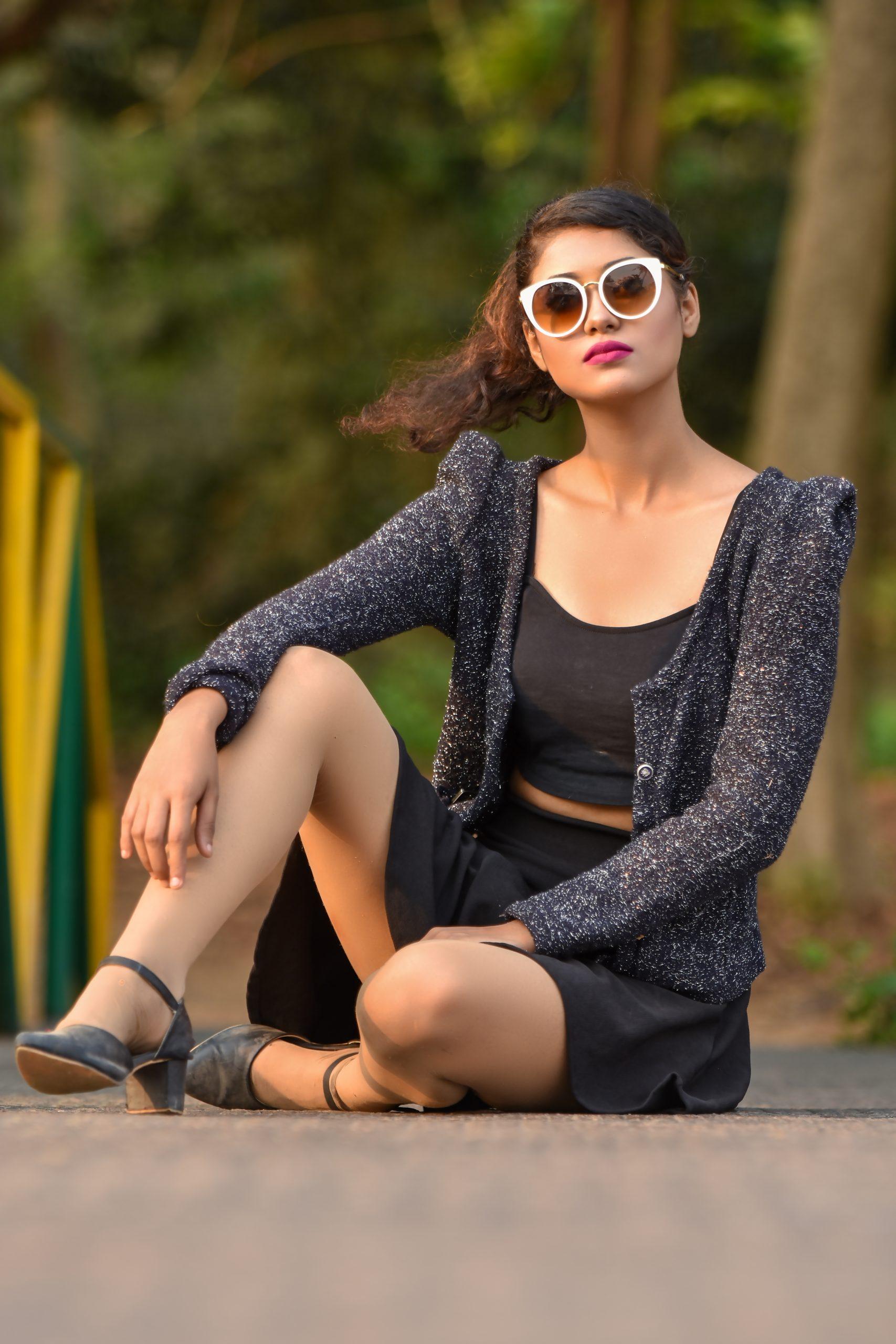 Female model posing on the road