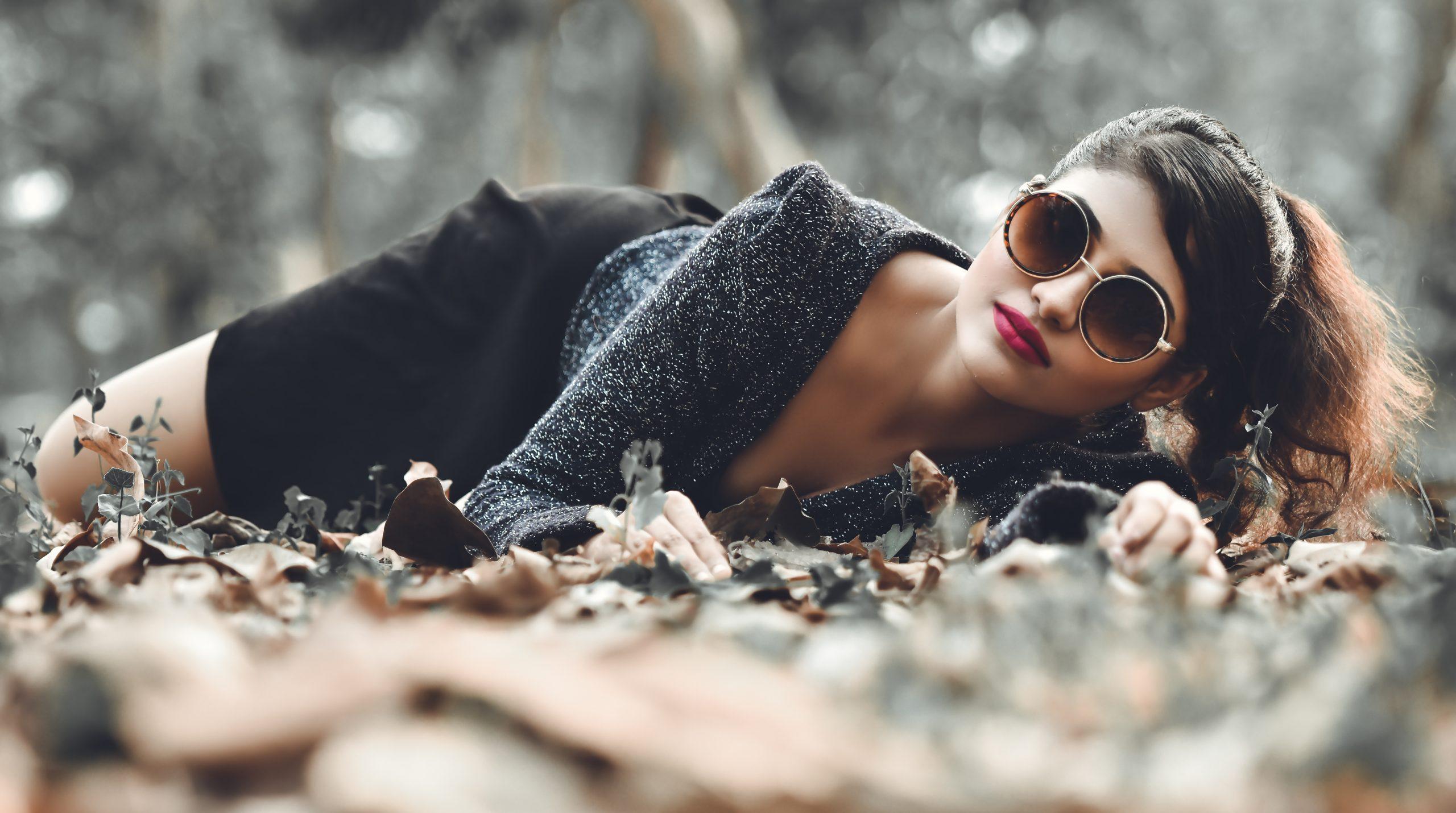Female model posing with sunglasses