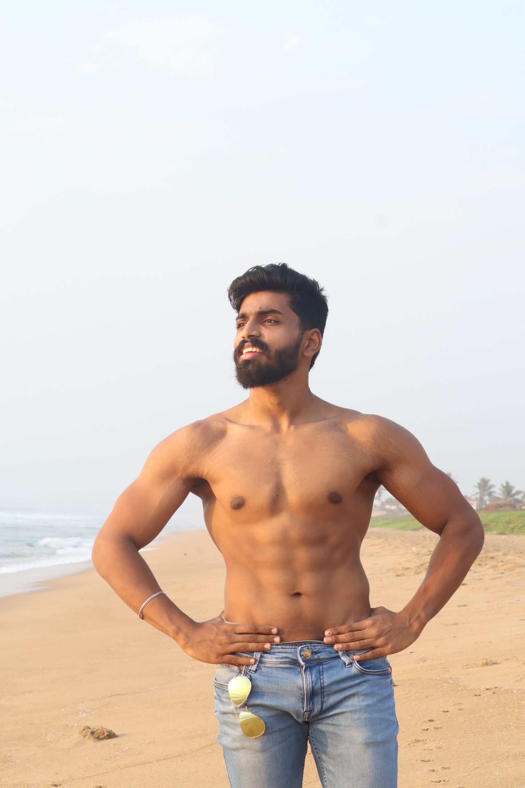 Fitness model posing on beach