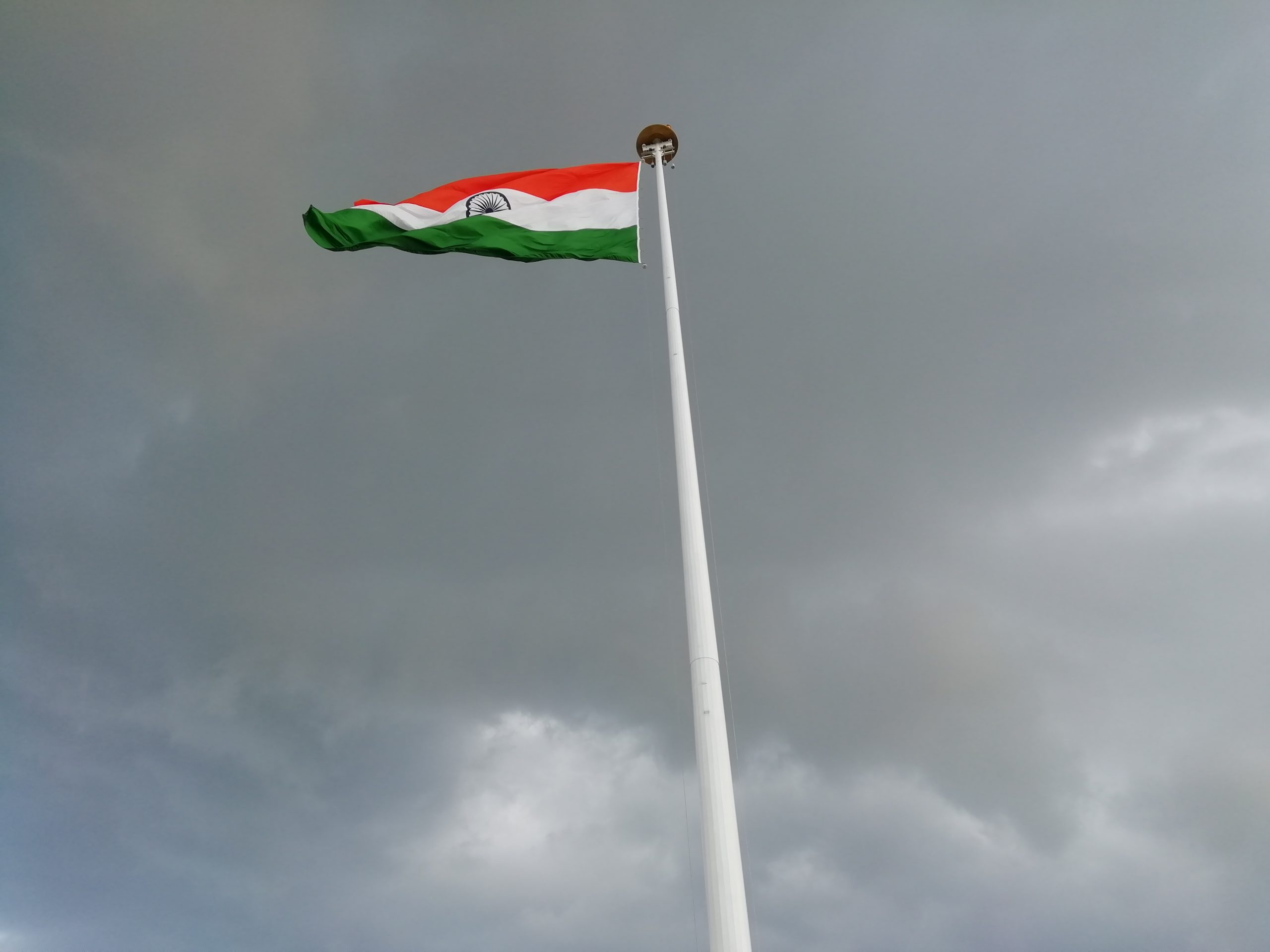 Indian flag under grey sky