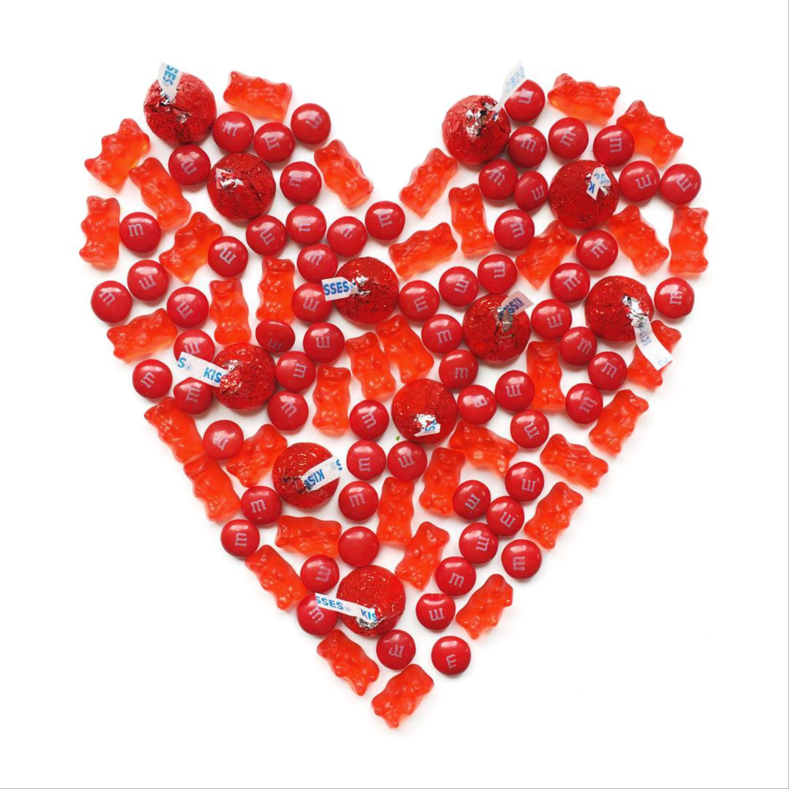 A heart shape made with red candies