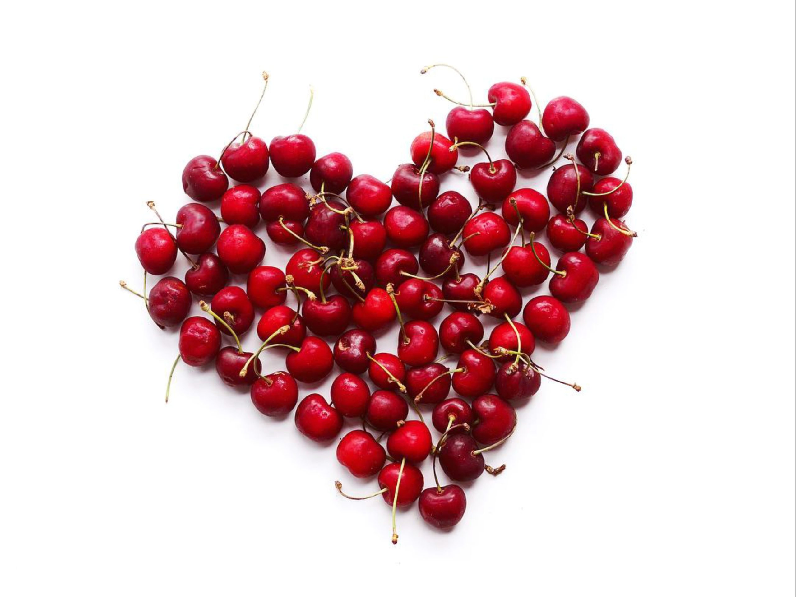 Heart shape made with red berries