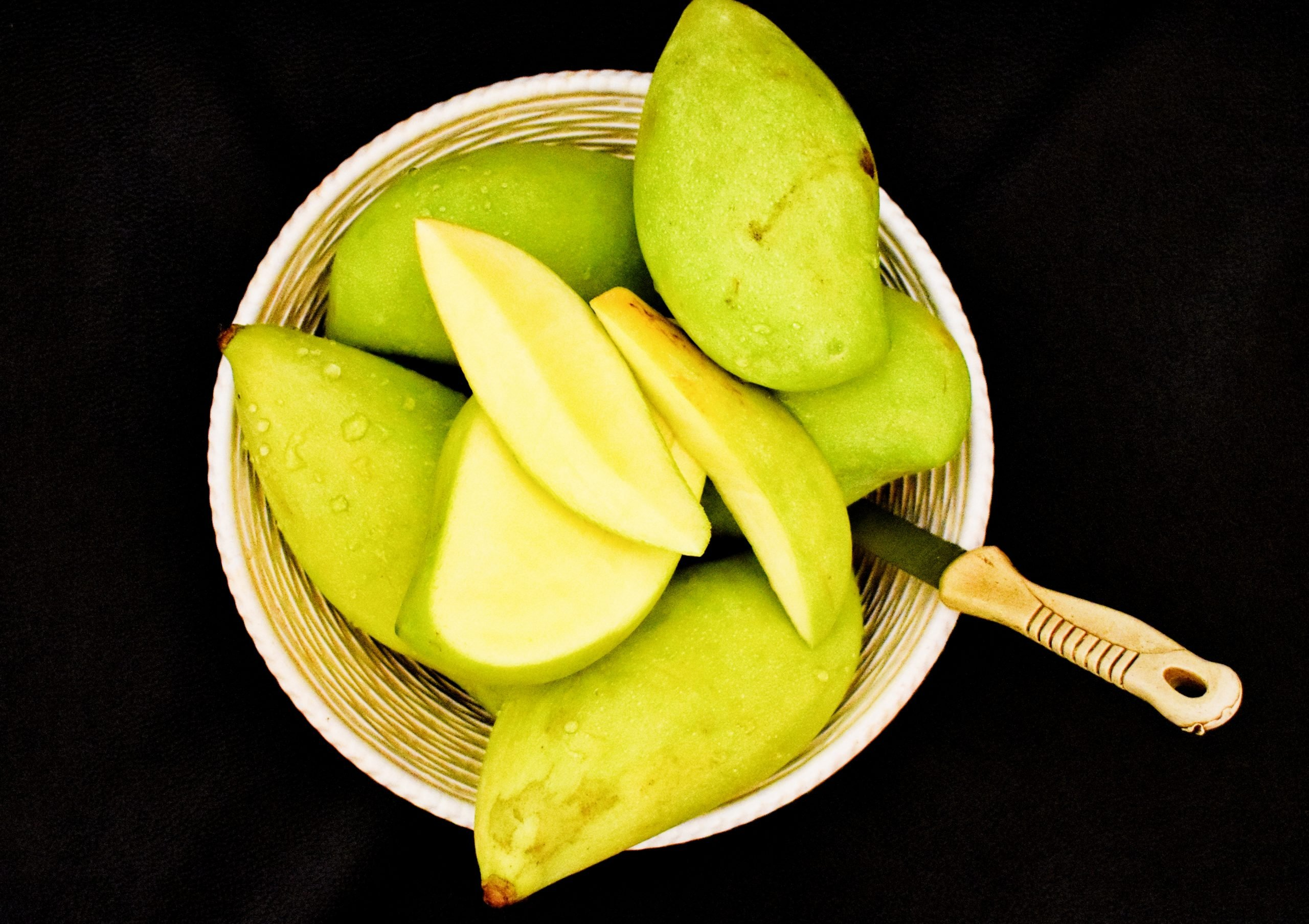 Green Mangoes in a basket